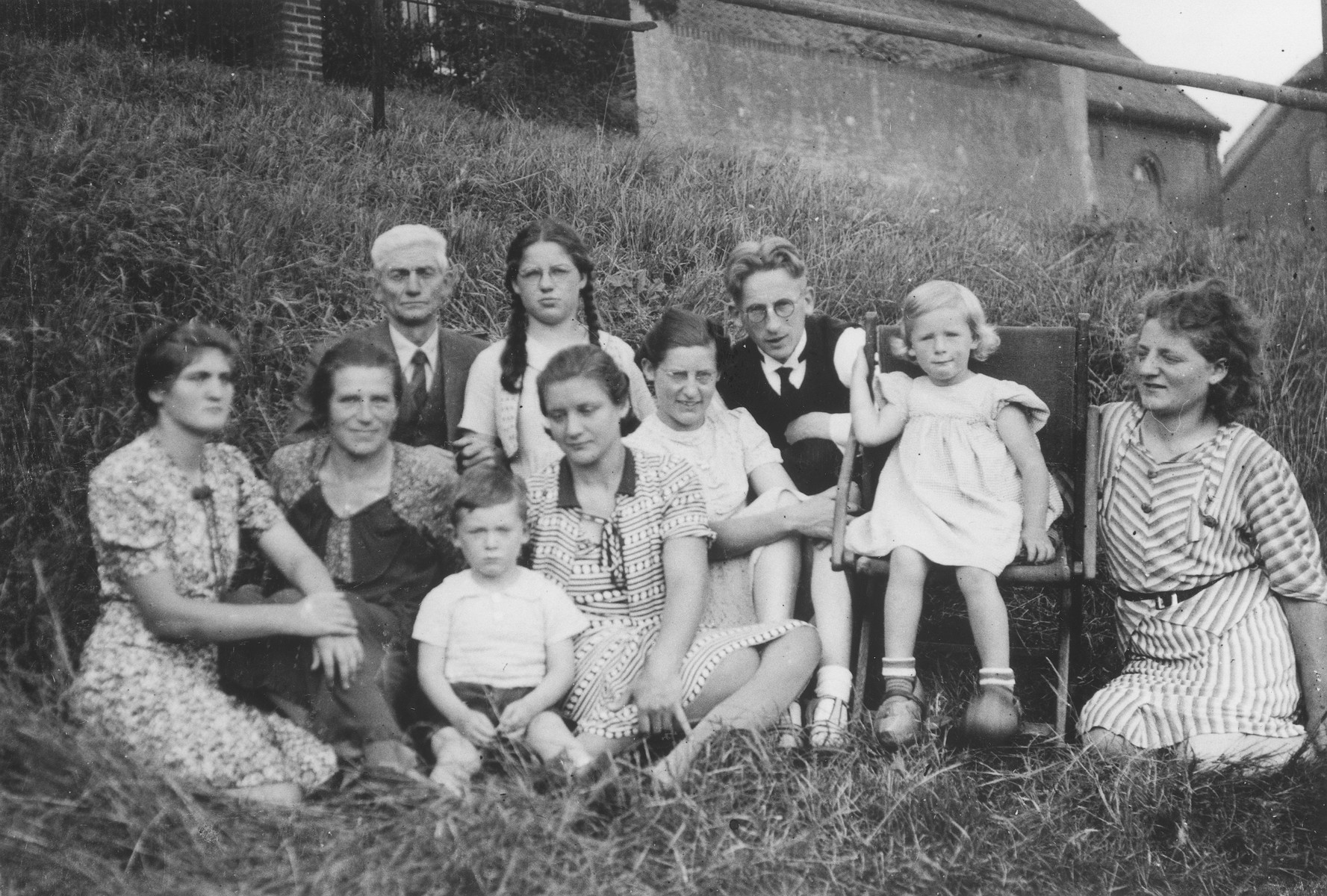 Portrait of the family of Carl Johann and Helene Derksen who hid Doris Bloch during the German occupation of Holland.  Pictured are Carl Johann and Helene Derksen with their children Elly, Miets, Ans, Marta and Leen, their son-in-law, Pim ter Braak, and their grandchildren, Ger and Heleen.  The Derksens were later recognized by Yad Vashem as one of the Righteous among the Nations.