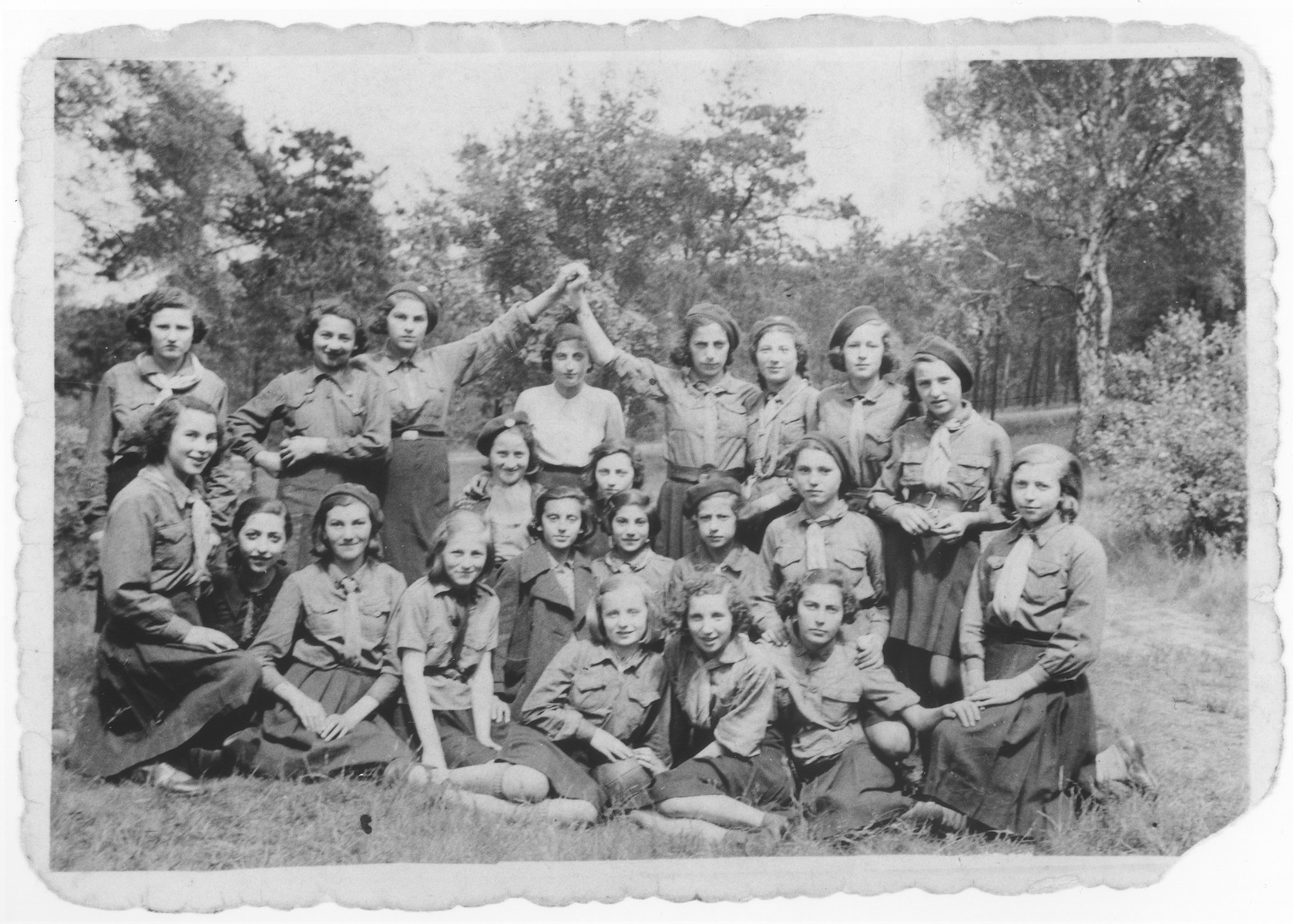 Group portrait of members of a Jewish girl scouting movement on an outing.  Among those pictured are Hela Szpiro, Estusia Fromer, Genia Dunska, Hadassa Cudzynowski, Rozia Feller, and Marisza Stibelman.