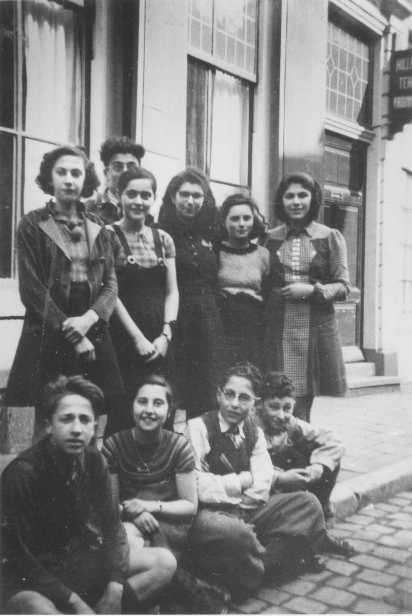 Students of the Jewish school in Zwolle pose on the street in front of the school building.  Doris Bloch is pictured standing in the back row, second from the left.