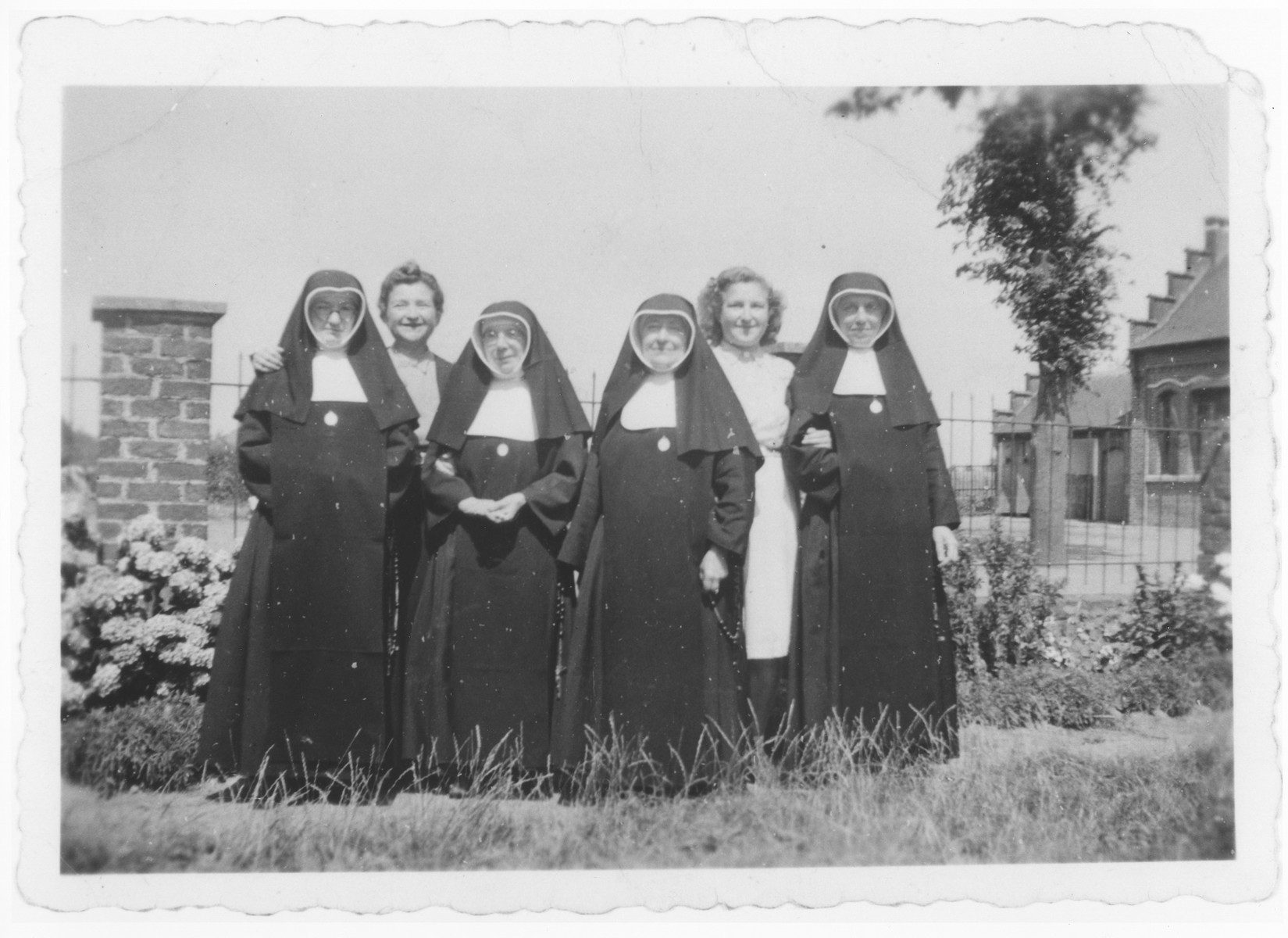 Ursula Klipstein and her mother pose with Sisters Catherine, Odile, Elisabette and Huberte at the Soeurs de Sainte Marie convent near Braine-l'Alleud, where Ursula was hidden during the war.