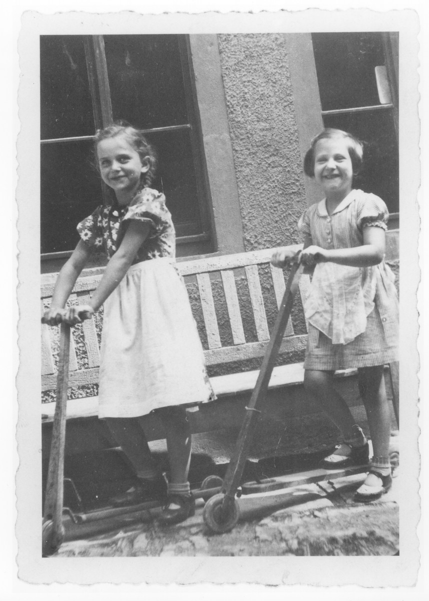 Ursula Klipstein (right) and a friend ride on scooters.