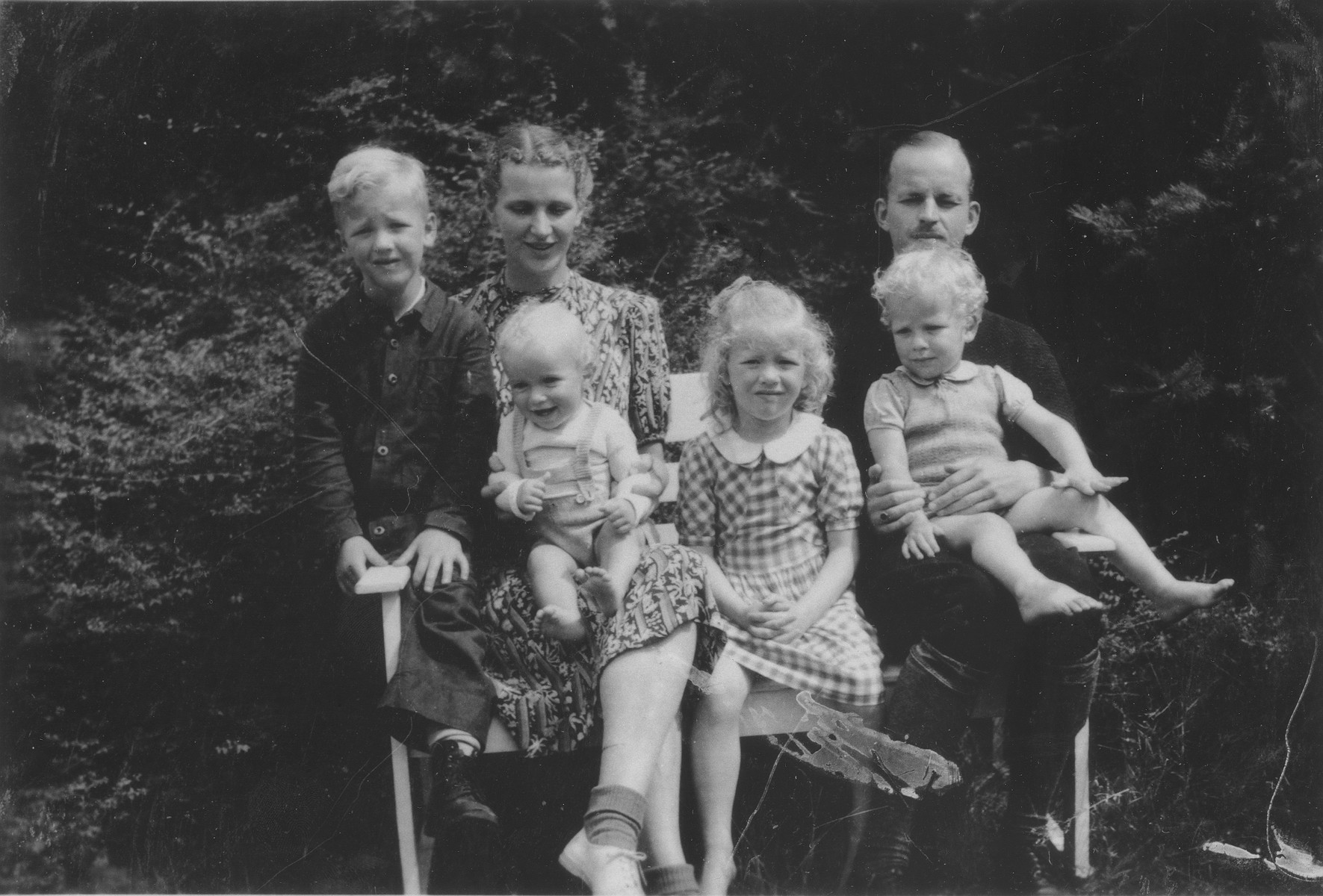Portrait of the family of the Rev. Adriaan and Ank Faber who hid Gerda Bloch during the German occupation of Holland.  Pictured are Rev. Adriaan and Ank Faber with four of their children:  Edward, Pieter, Hanna and Rene.  The family was later recognized by Yad Vashem as one of the Righteous among the Nations.