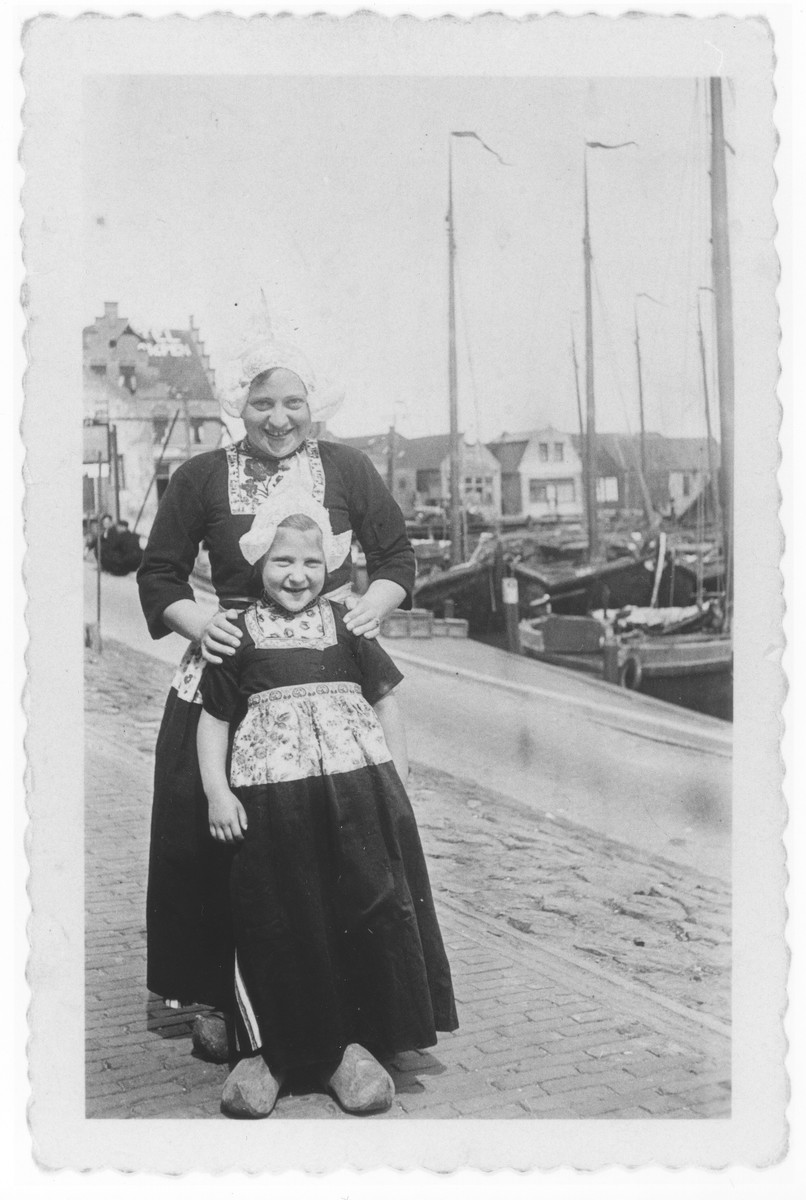 Ursula Klipstein and her mother dress in traditional Dutch costumes during a visit to Volendam.