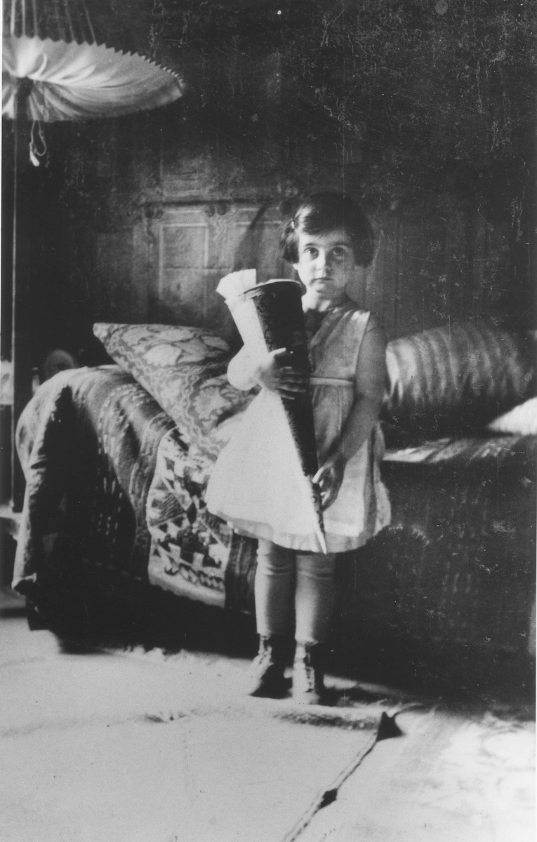 Doris Bloch holds a Schultuete [a school cone] filled with candies on her older sister's first day of school.