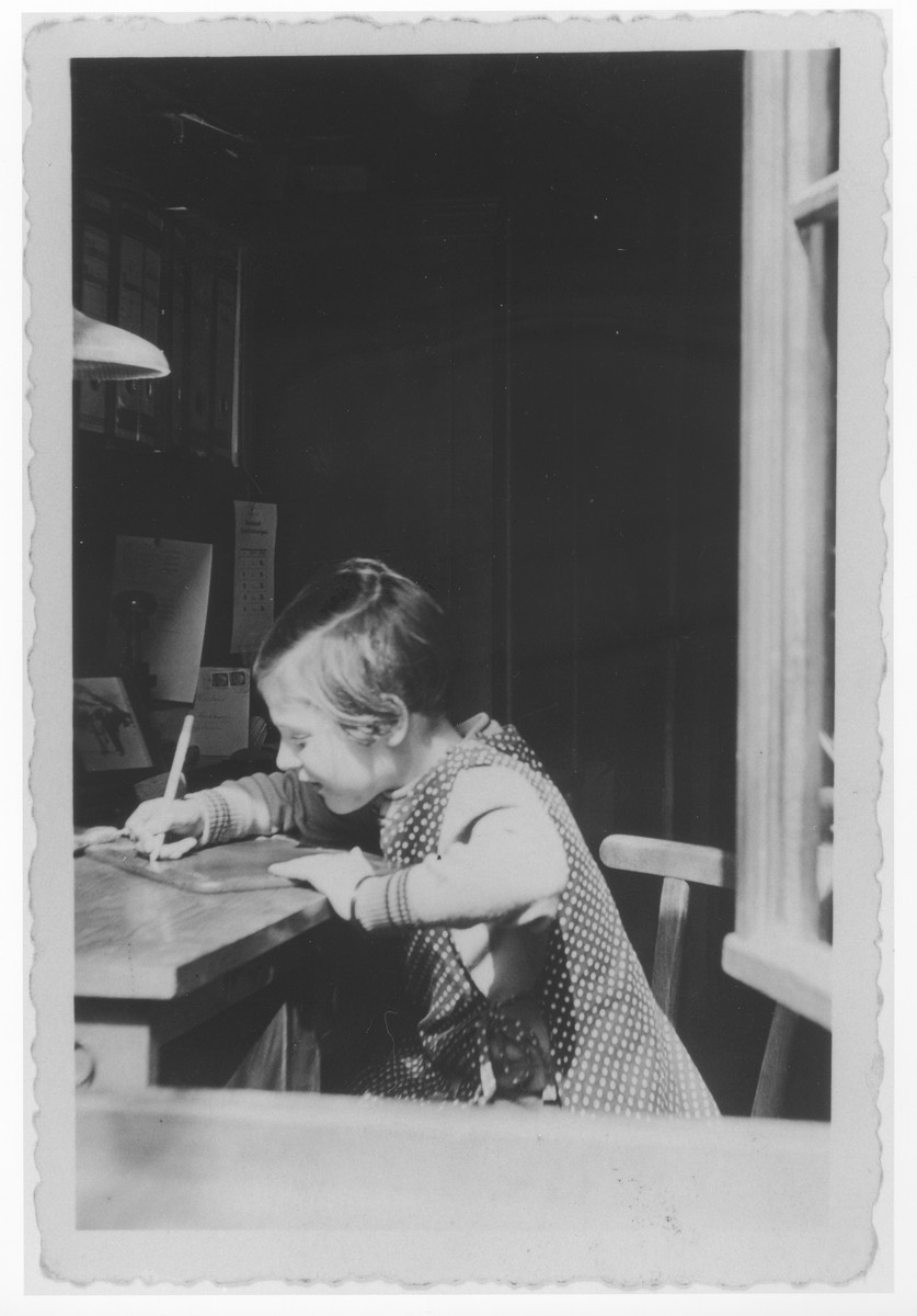 Ursula Klipstein does homework at a desk in her room.