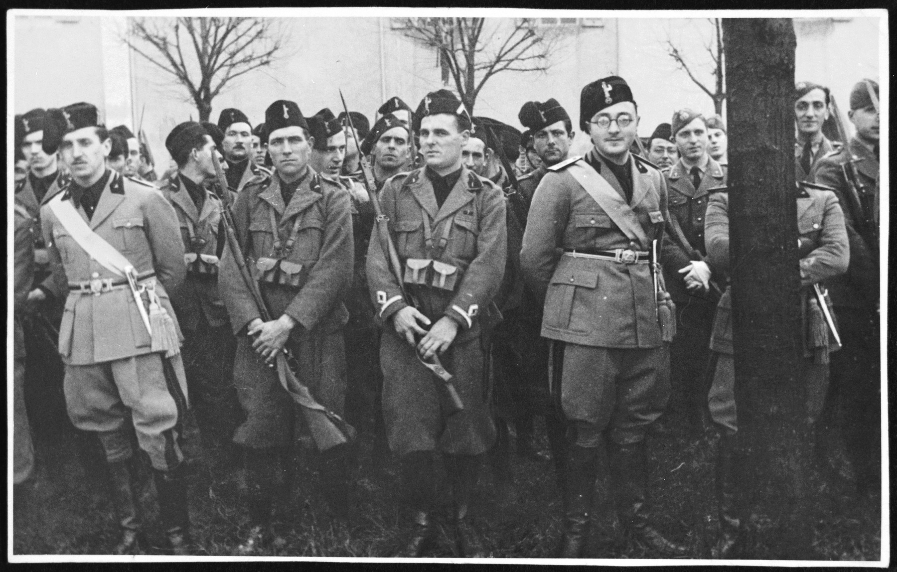Group portrait of Italian Fascists in Pisa.  Ettore Abenaim (right, b. 1909) enlisted in the Voluntary Fascist Militia when Jews were still permitted to belong.  He later was later deported to Auschwitz and perished.
