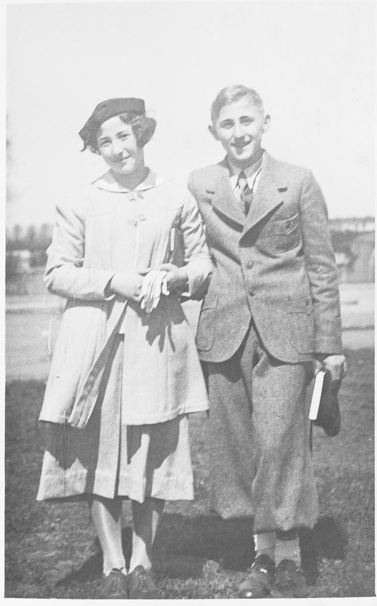 Margot (Miriam) and Gerhard (Gad) Beck pose outside on the day of his Bar Mitzvah.