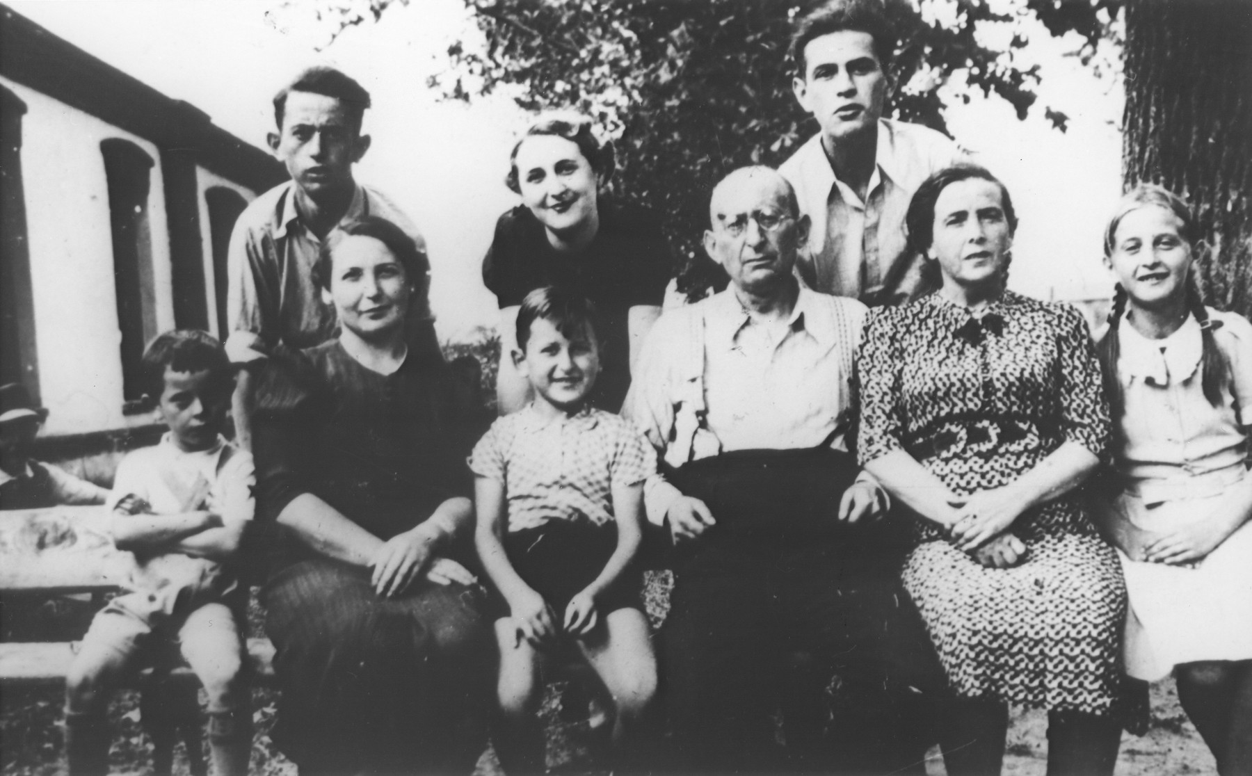 Portrait of the Katz family in Ostrowiec, Poland.    Standing in the back, from left, are: Izak; a cousin and Moniek.  Seated from left are: Rubin, the donor; an aunt from Germany; her son; Mosze; Gila and Fela Katz.