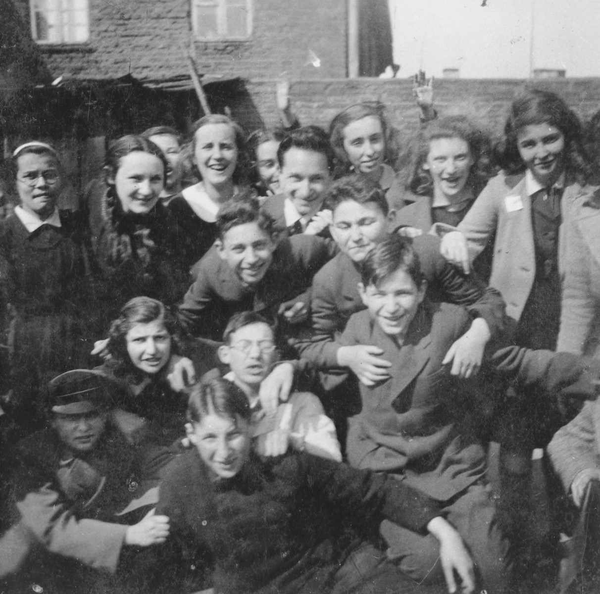 Group portrait of Jewish students of the Schwabes Hebrew gymnasium in Kovno, Lithuania.  Among those pictured is Dov Levin (center wearing glasses).