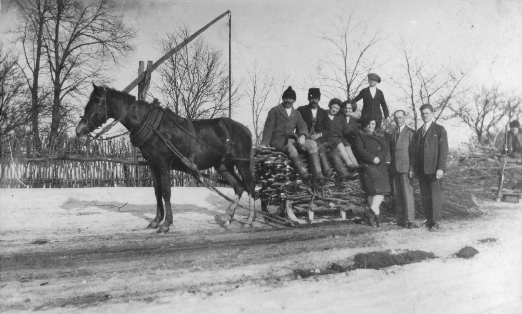 The Gurfein family poses on a horse-drawn sleigh while on vacation in Raczyna, Poland.  Among those pictured is Basia Gurfein (front).