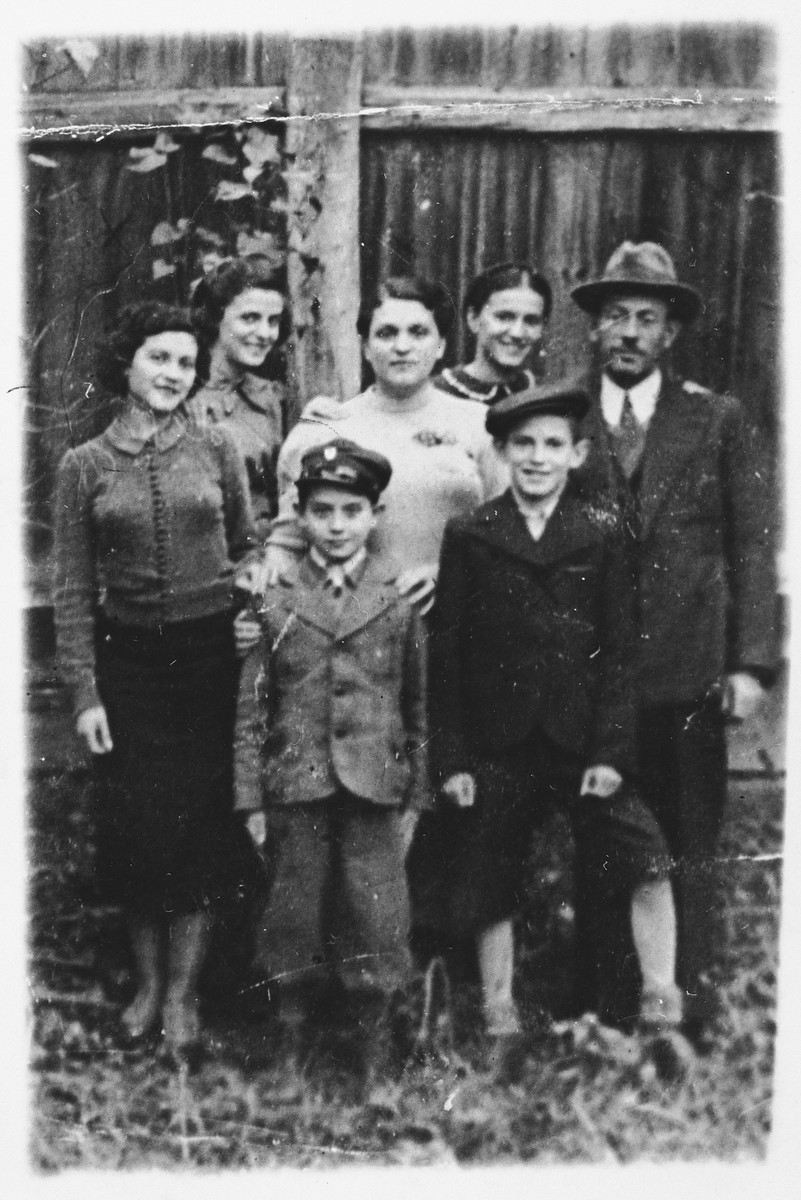 Portrait of the Felman family in Proszowice, Poland.  Among those pictured are Rozia Felman (second from the left), Esther Felman (center) and Israel Felman (right).