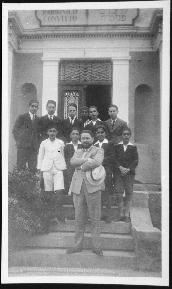 Rabbi Riccardo Pacifici  poses with students at the Rabbinical College in Rhodes in front of the main entrance.