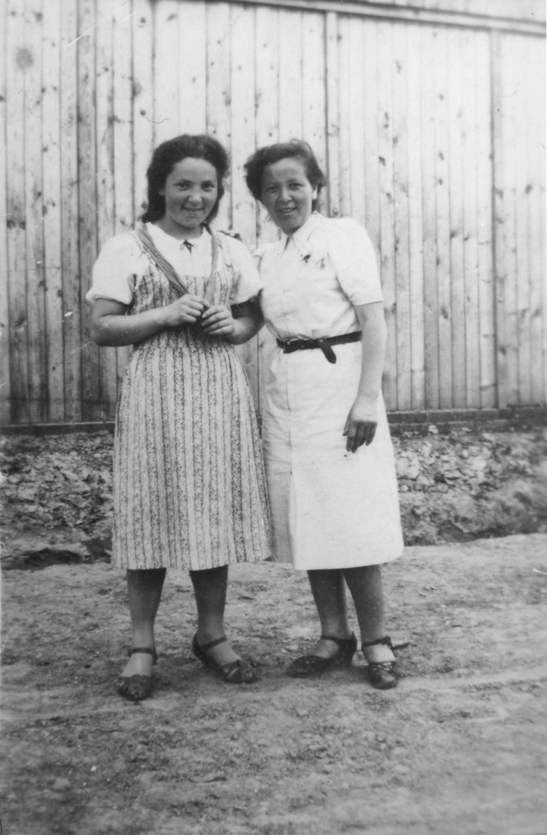 Two Jewish sisters pose outside during a visit to their grandparents' home in Pruchnik, Poland.  Pictured are Basia (left) and Ita Gurfein.