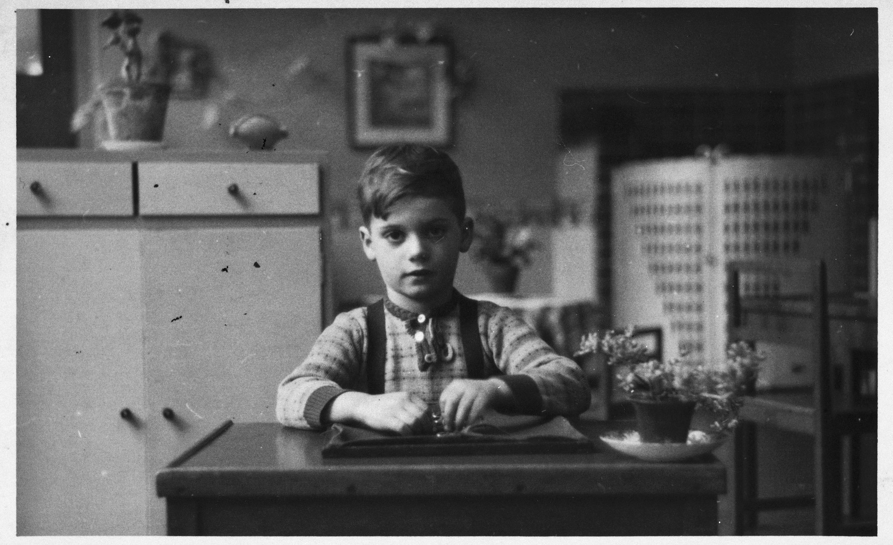 Peter Metzelaar sits at a kitchen table on a farm where he was hiding in the Netherlands.