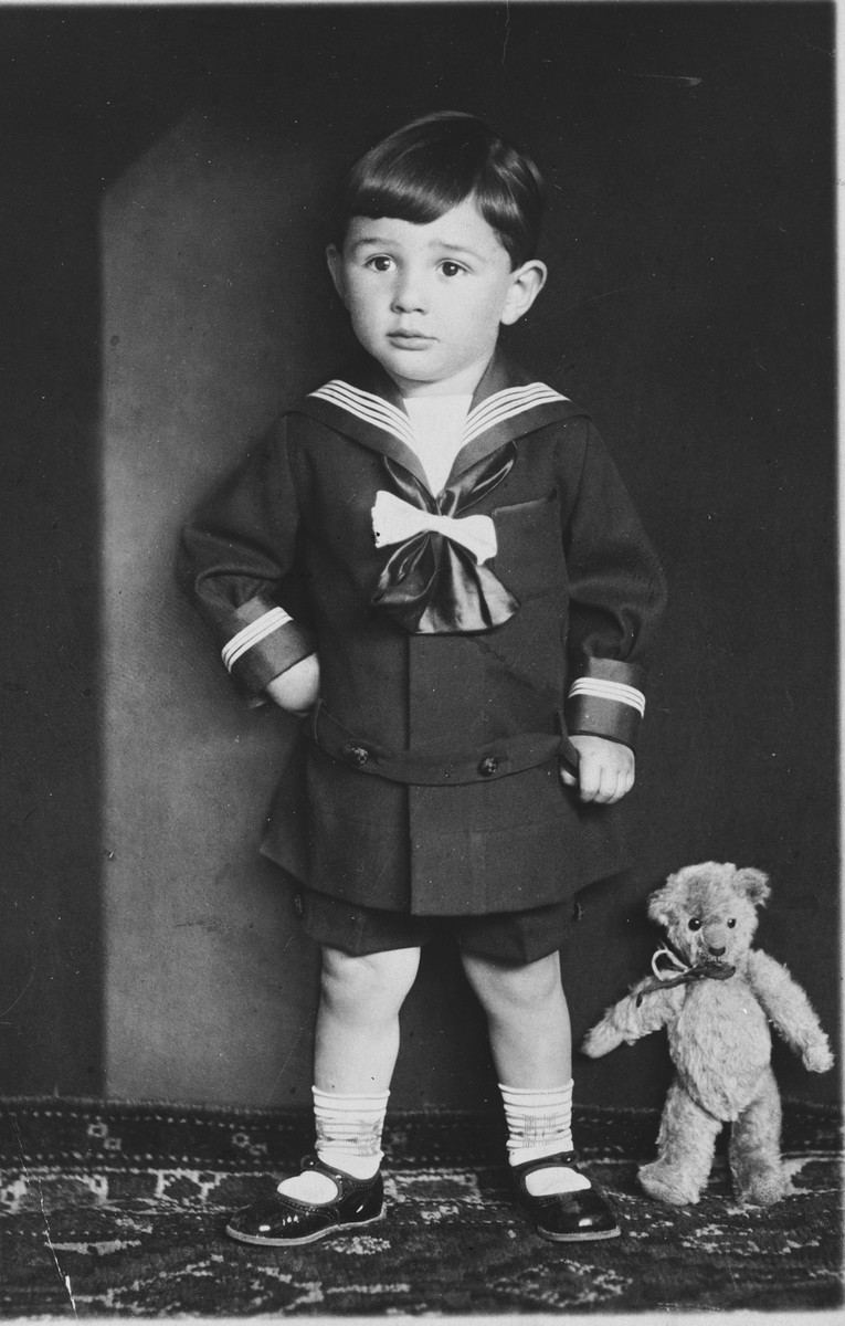 Studio portrait of Arieh Klein with his teddy bear.