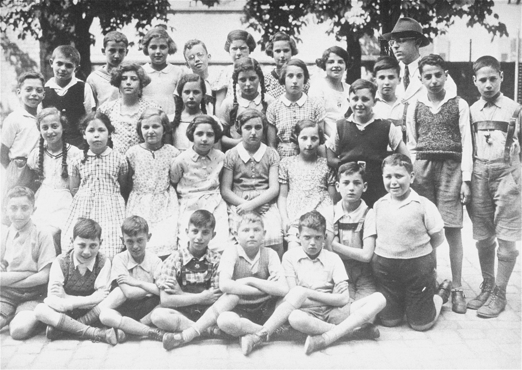 Group portrait of pupils in the fifth grade at a Jewish school in Karlsruhe, Germany that had been relocated to one floor at the 'Holzbodengymnasium' a special school for mentally disabled children.   Among those pictured is the teacher, Ludwig Hemmerdinger.