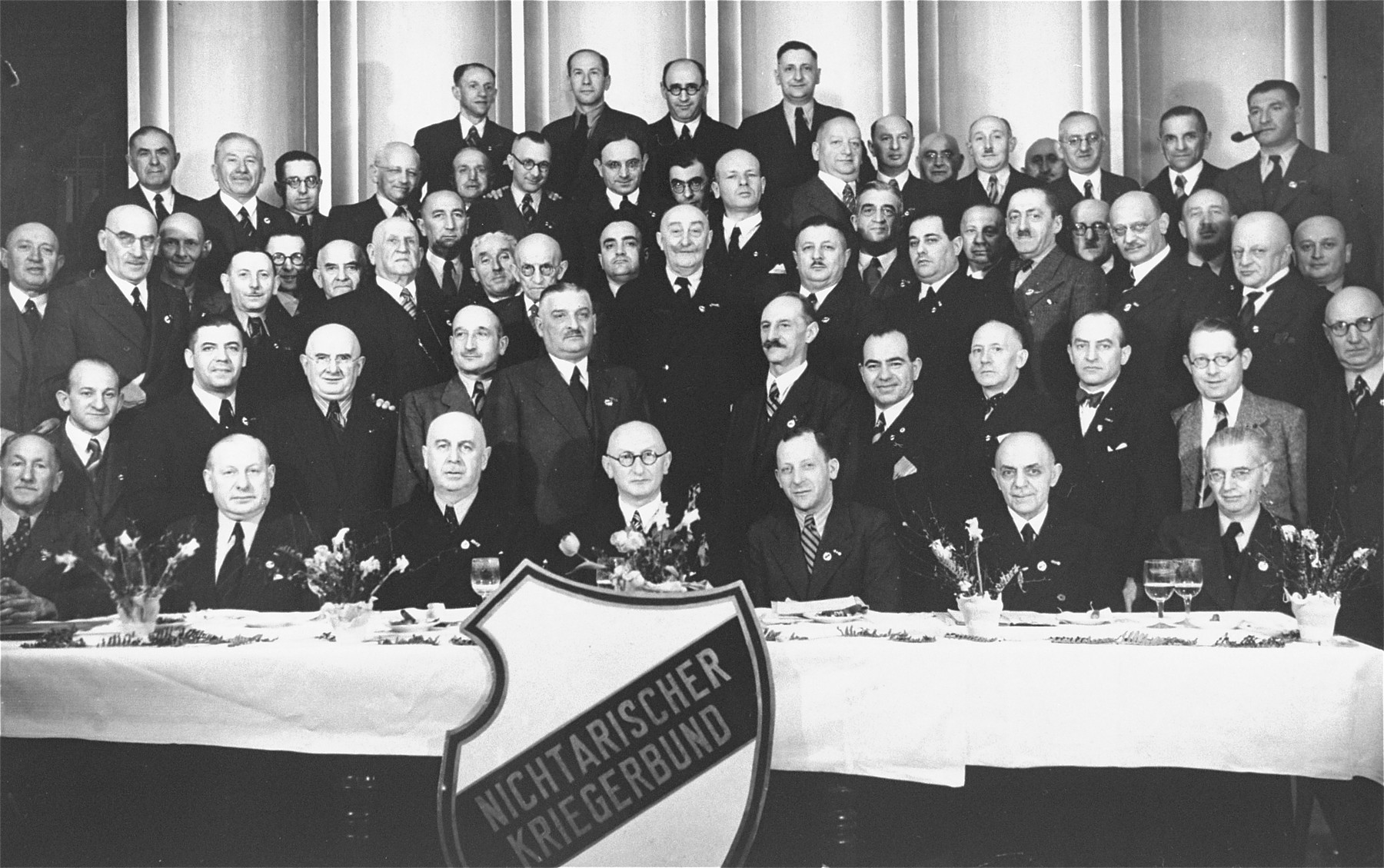 Group portrait of members of the Nichtarischer Kriegerbund [Non-Aryan Jewish War Veterans Society].  Among those pictured is Georg Anker (1885-1955, third row, fourth from the left).