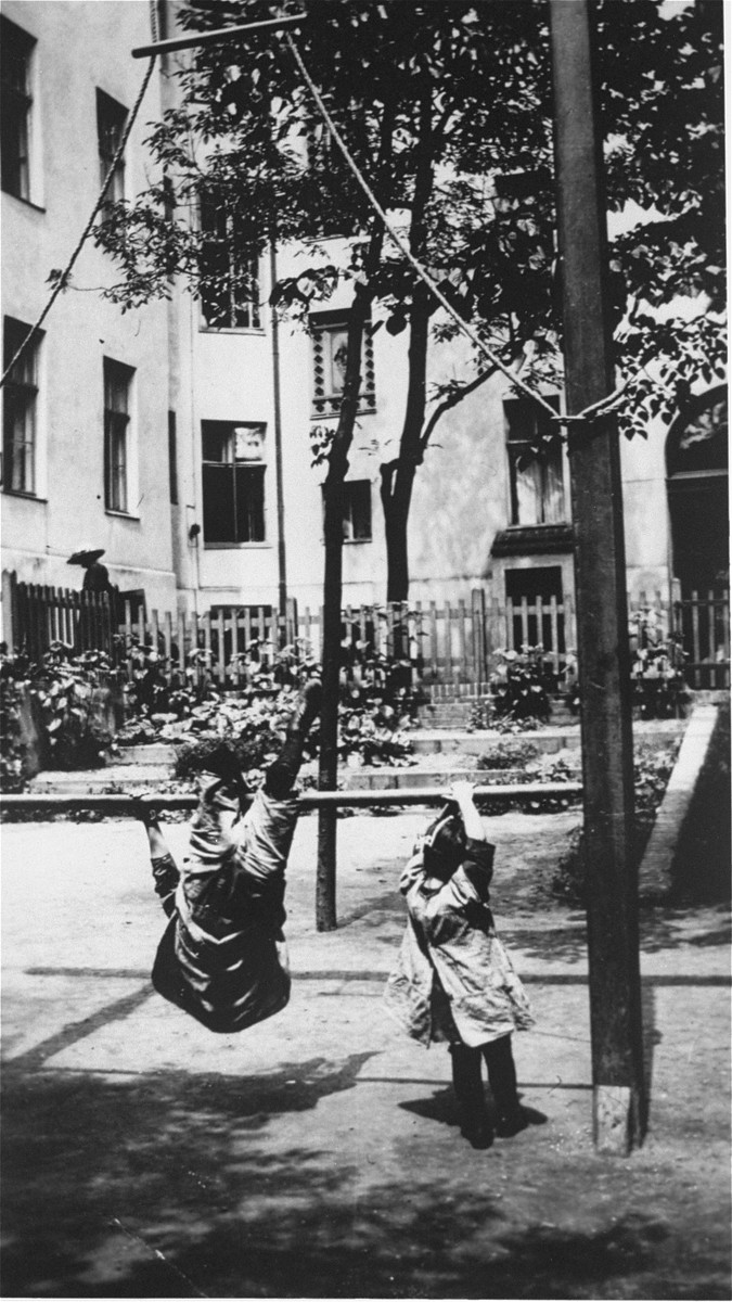 Children play outside in the playground of the Jewish Kinderheim [children's home] located at Ferbelliner Strasse 92 in Berlin.