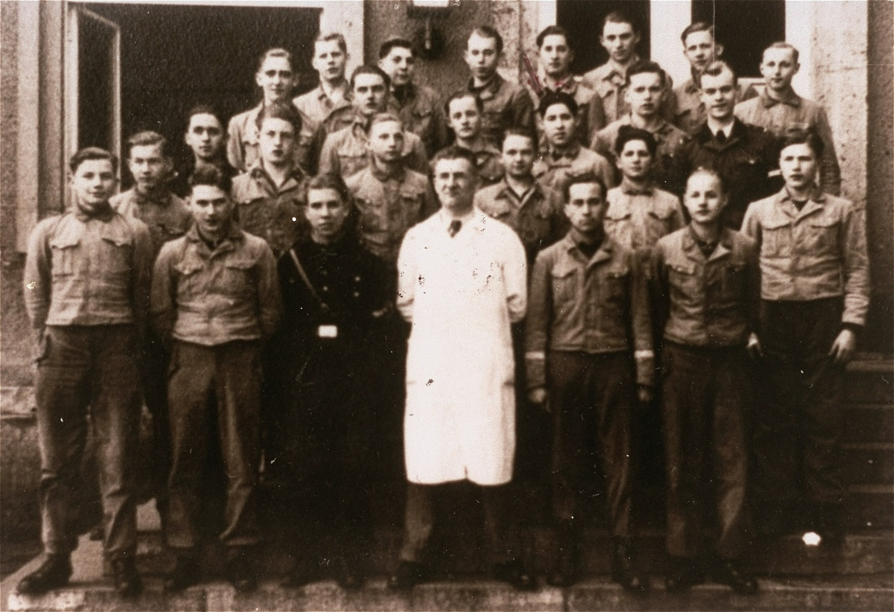 Group portrait of students and their instructor at the Hitler Youth training center in Braunschweig.   Among those pictured is Solly Perel, a German Jew who was living in hiding at the school (third row from the front, third from the right.)