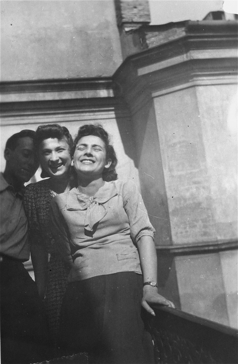 Polish rescuer Wladyslaw Wojcik poses with Irka and Henia Cymerman on the balcony of their apartment in the Warsaw ghetto.    Pictured from left to right are: Wladyslaw Wojcik, Irka Cymerman and Henia Cymerman.