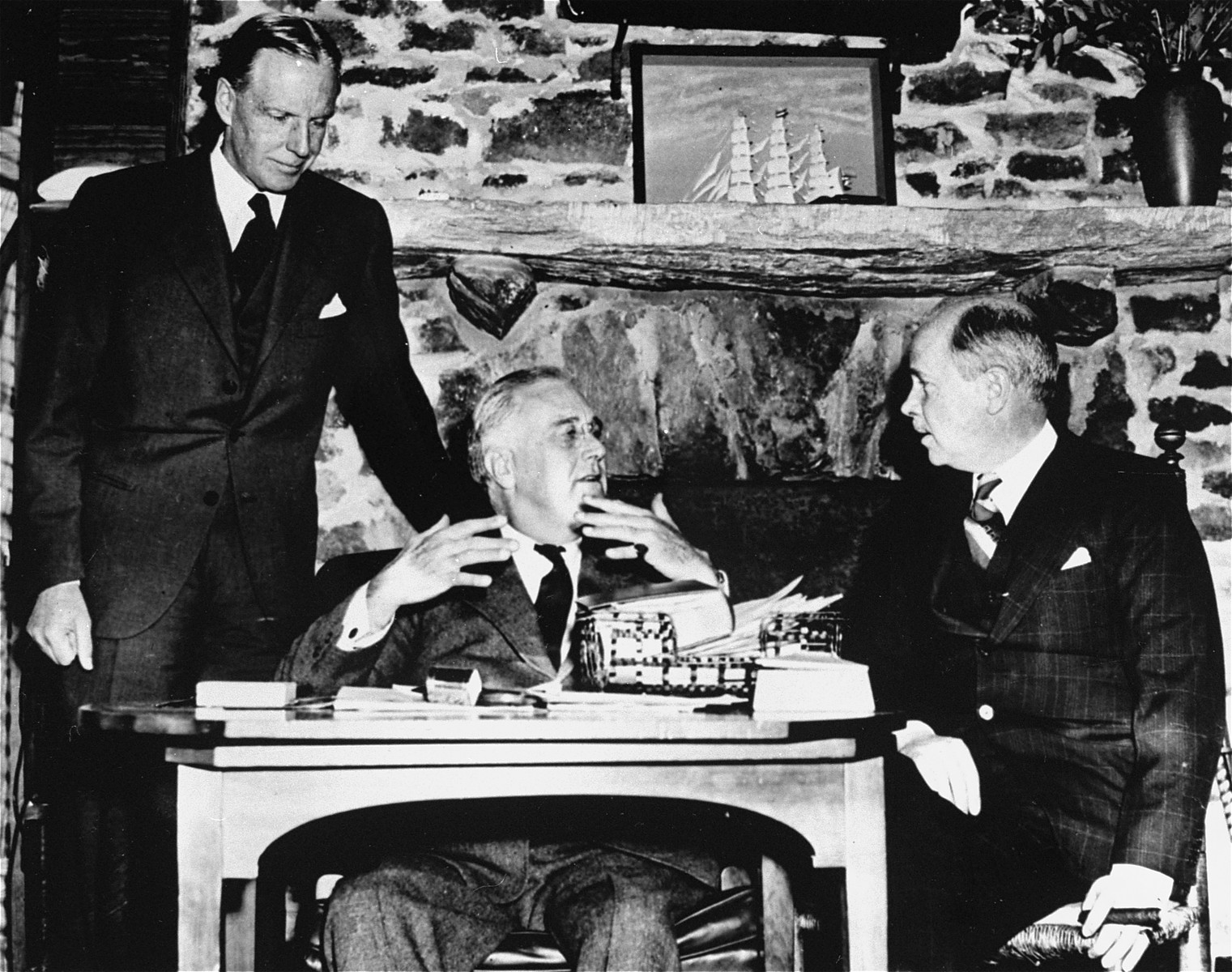 Franklin Delano Roosevelt confers with American ambassadors William Phillips (left), ambassador to Italy, and Hugh Wilson (right), ambassador to Germany.
