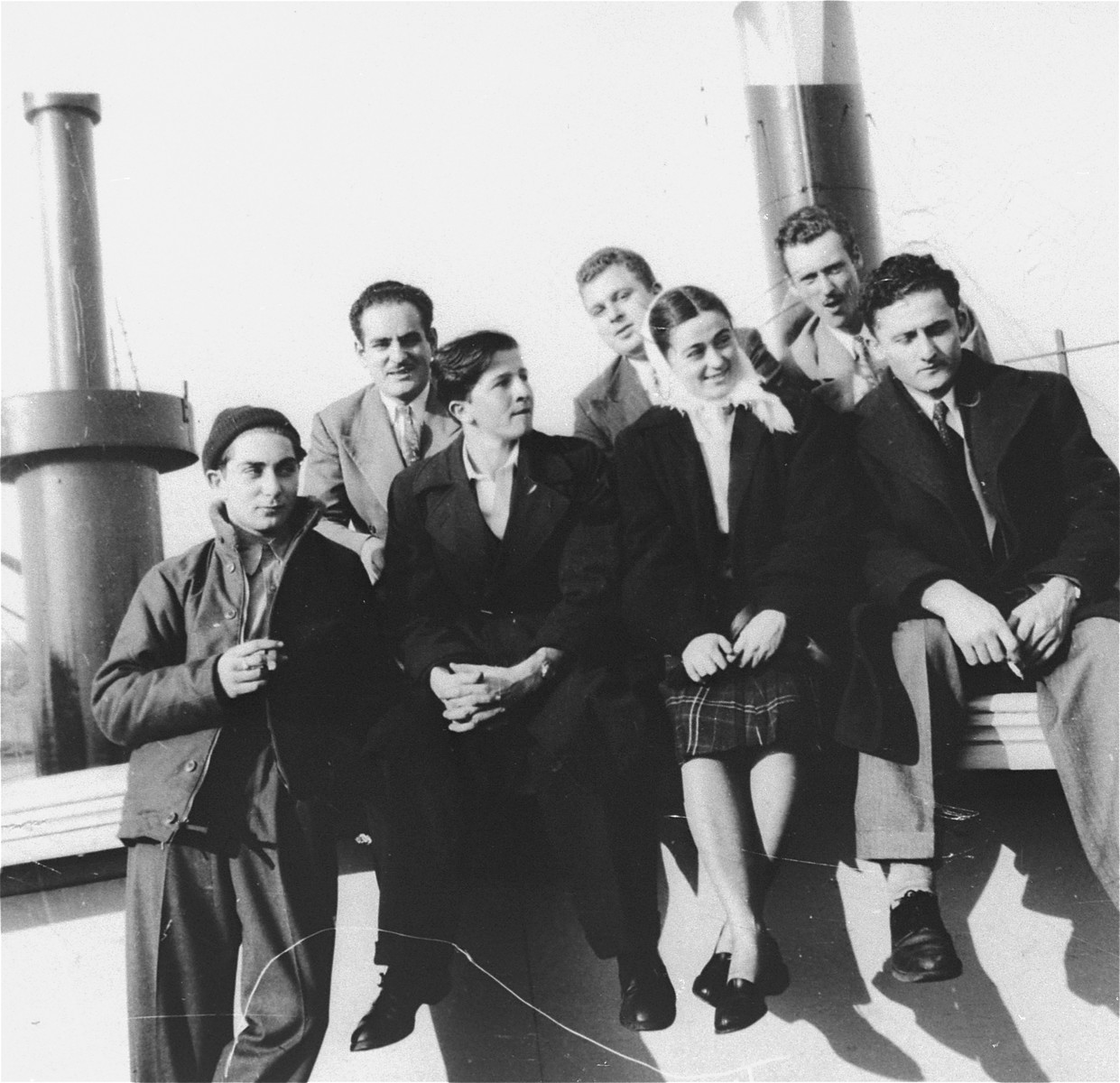 Crew members of the President Warfield (later the Exodus 1947) pose with friends on the deck of the ship before its departure for Europe.   Pictured from left to right are: Sam Schulman, Eli Kalm, Itzhak (Ike) Aronowitz, Joe Gilden, unnamed visitor, Paul Yarin and an unnamed visitor.