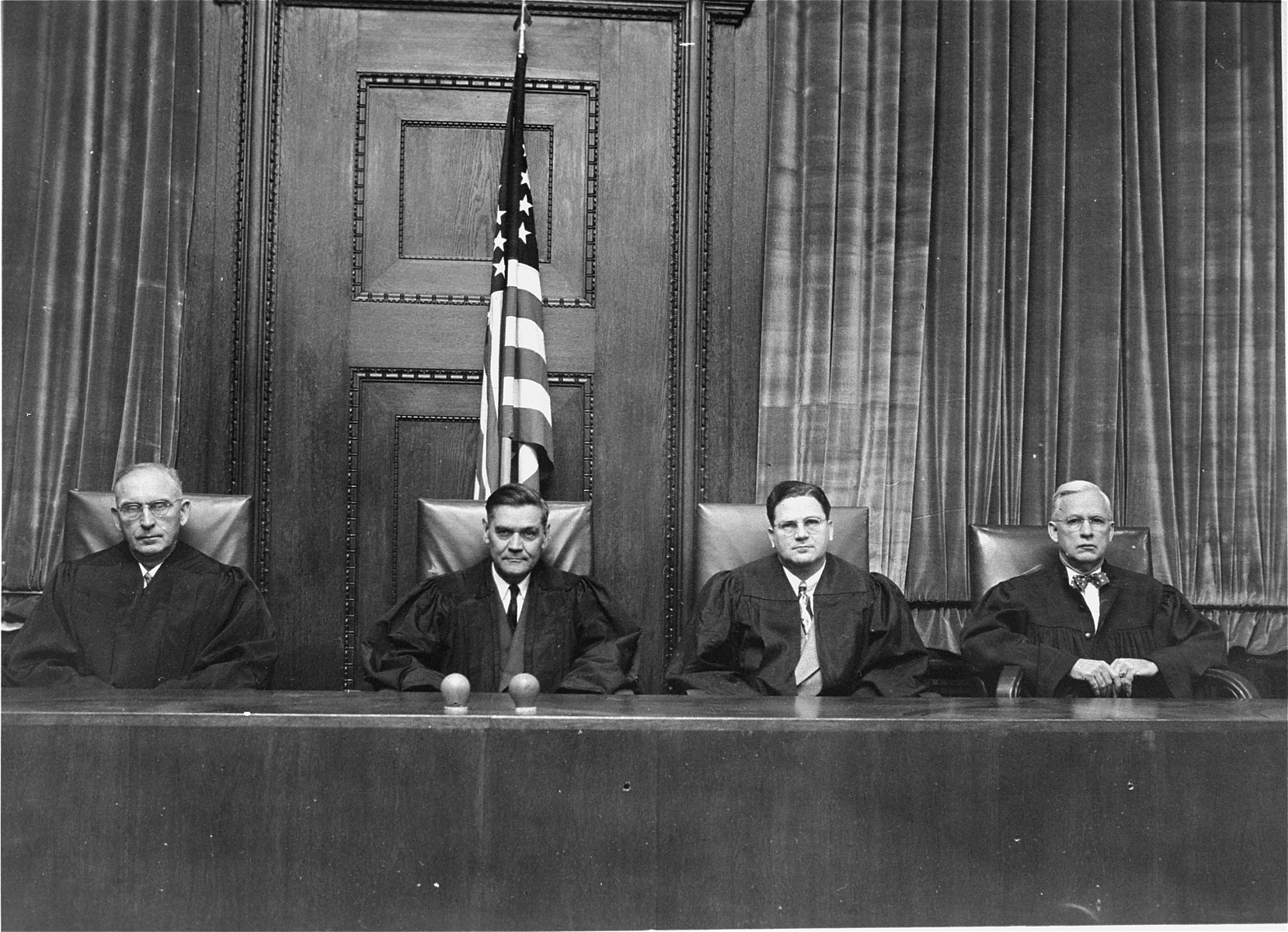 The judges of Military Tribunal VI during the I.G. Farben Trial.  From left to right are James Morris, Curtis G. Shake, Paul M. Hebert, and Clarence F. Merrell.