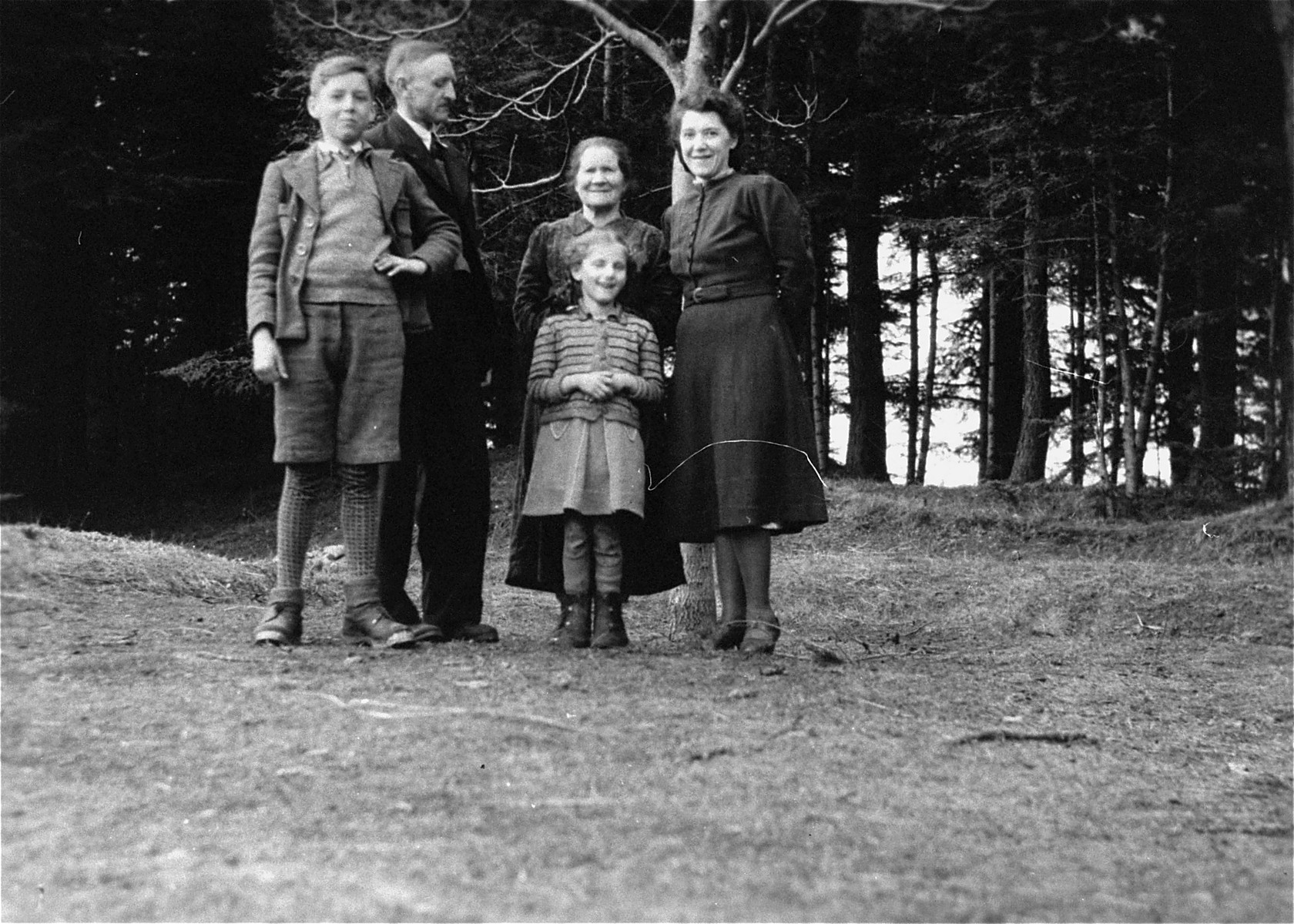 Dorota Fischbein poses with members of the Koszarski family who sheltered her during the war.