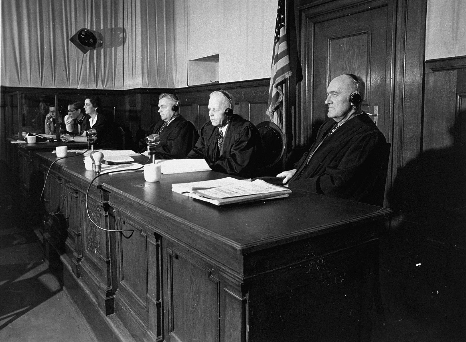 The judges of Military Tribunal V during the Hostage Case.  From left to right are Edward F. Carter, Charles F. Wennerstrum, and George J. Burke.