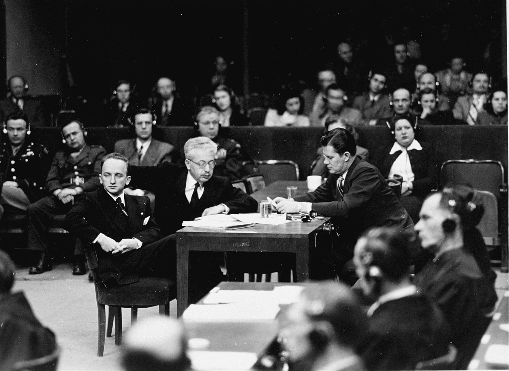 Members of the prosecution team at the Einsatzgruppen Trial.    Pictured from left to right are: Benjamin B. Ferencz, Arnost Horlick-Hockwald, and John E. Glancy.