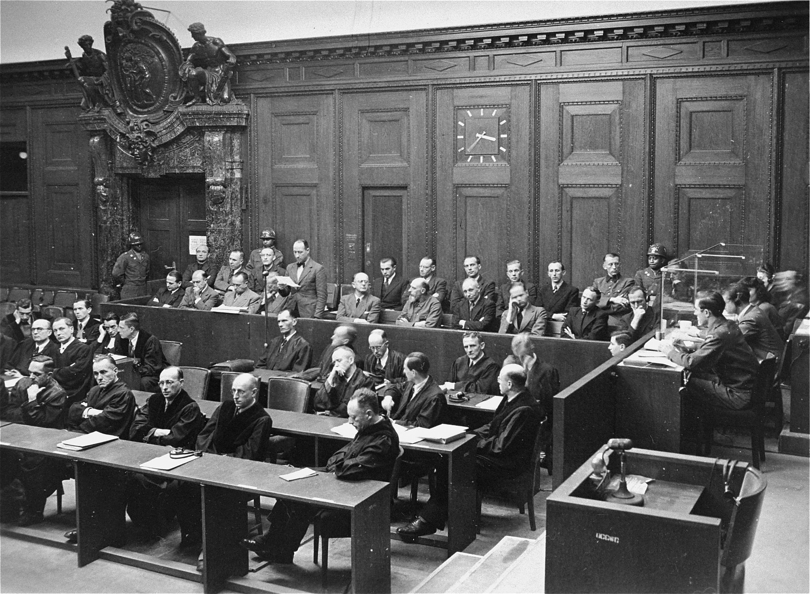 The defendants and their lawyers follow the proceedings of the Einsatzgruppen Trial.