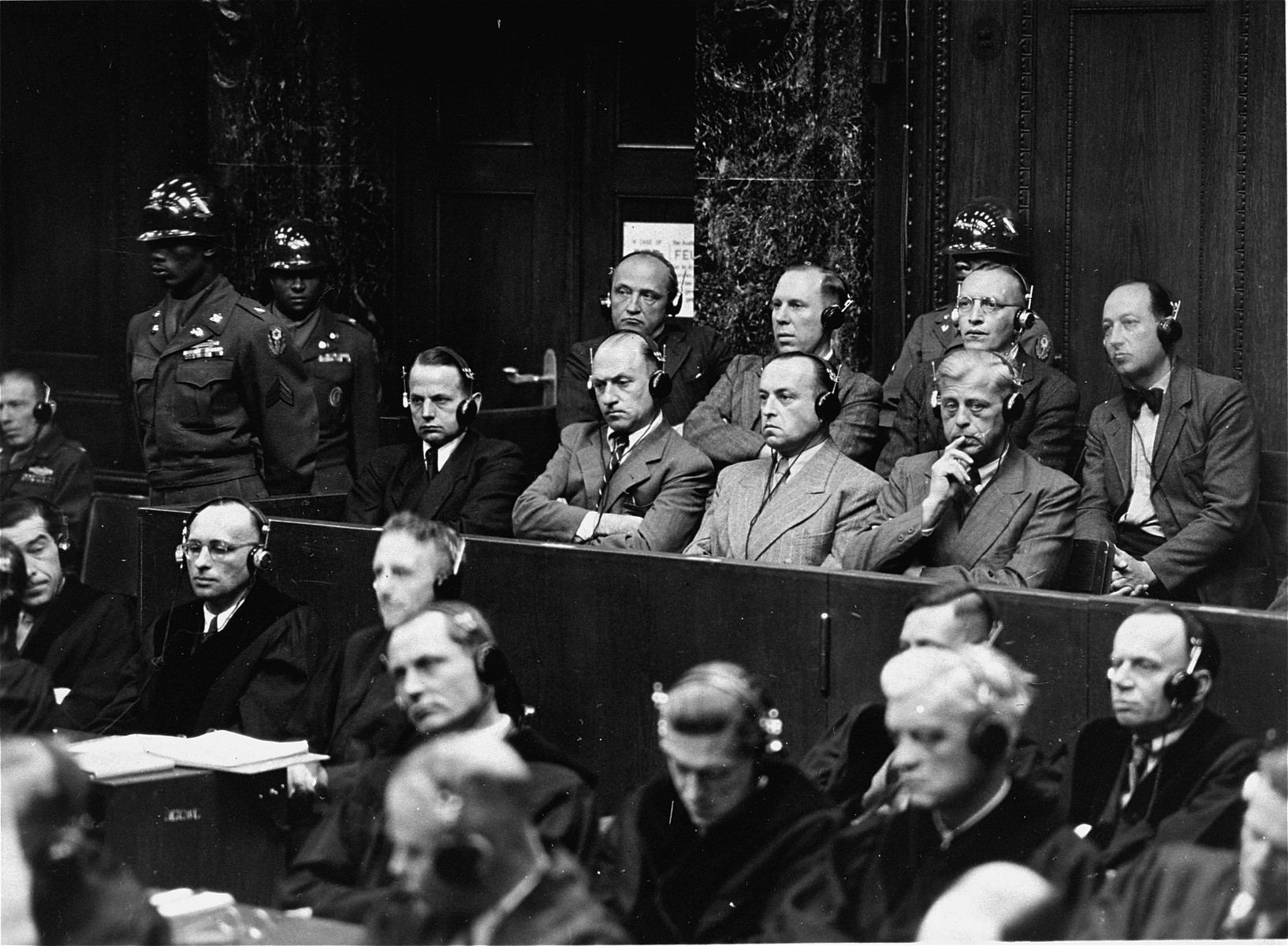 The defendants sit in the dock at the Einsatzgruppen Trial.