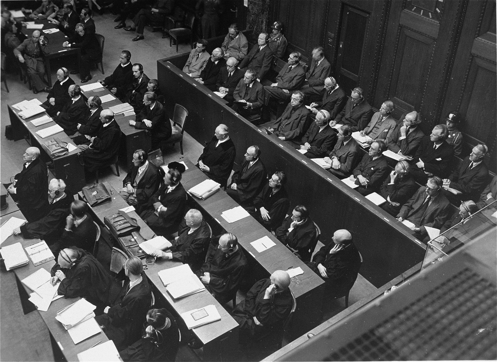 The defendants in the dock and their lawyers follow the proceedings of the I.G. Farben Trial.
