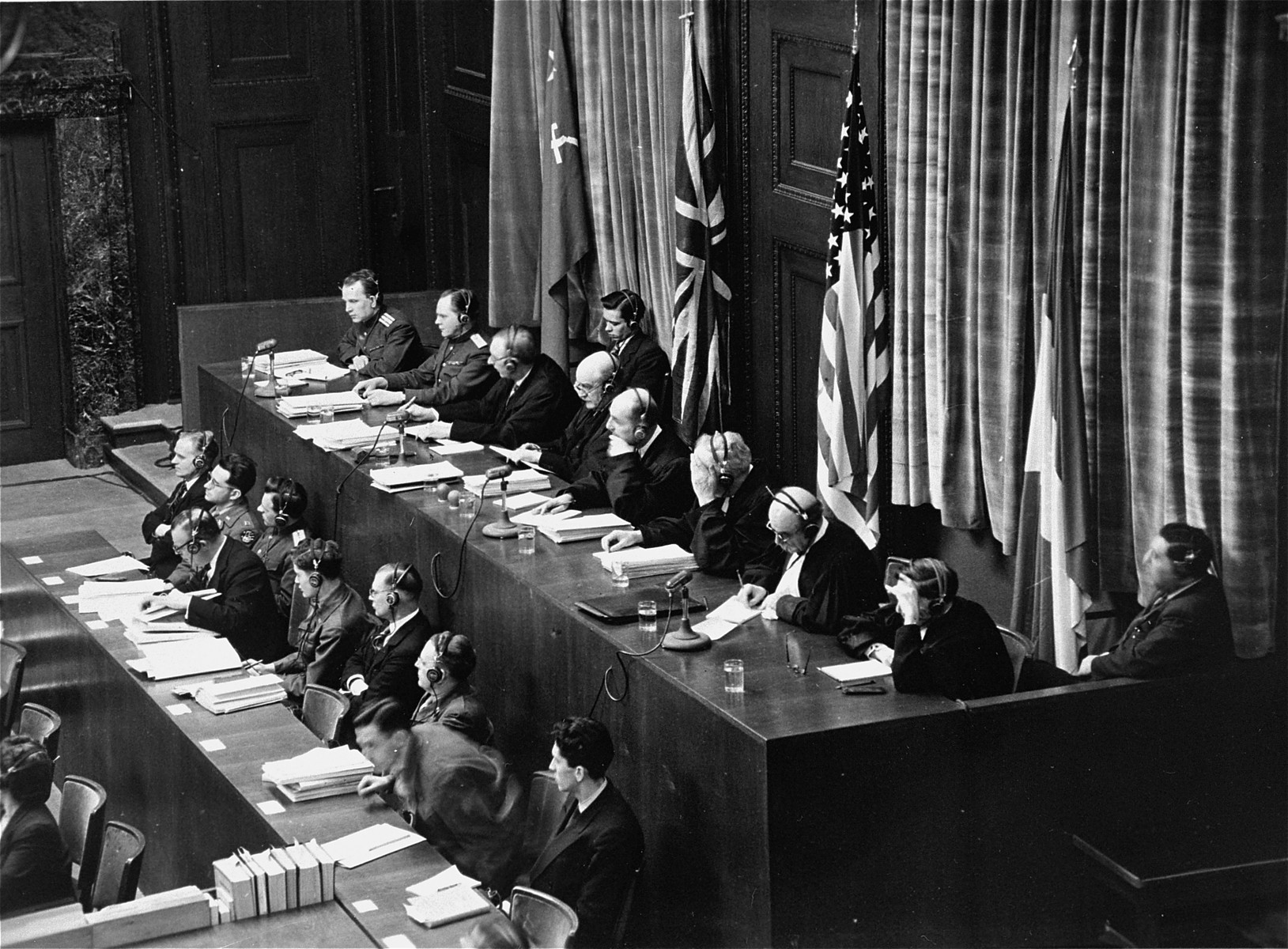 View of the judges' bench at the International Military Tribunal in Nuremberg.    Pictured from left to right are:  Lt. Col. A.F. Volchkov and Maj. Gen. Nikitchenko (U.S.S.R.); Justice Norman Birkett and Tribunal President Lord Justice Geoffrey Lawrence (Great Britain); Judge Francis Biddle and Judge John J. Parker (U.S.); Prof. Donnedieu de Vabres and Robert Falco (France).