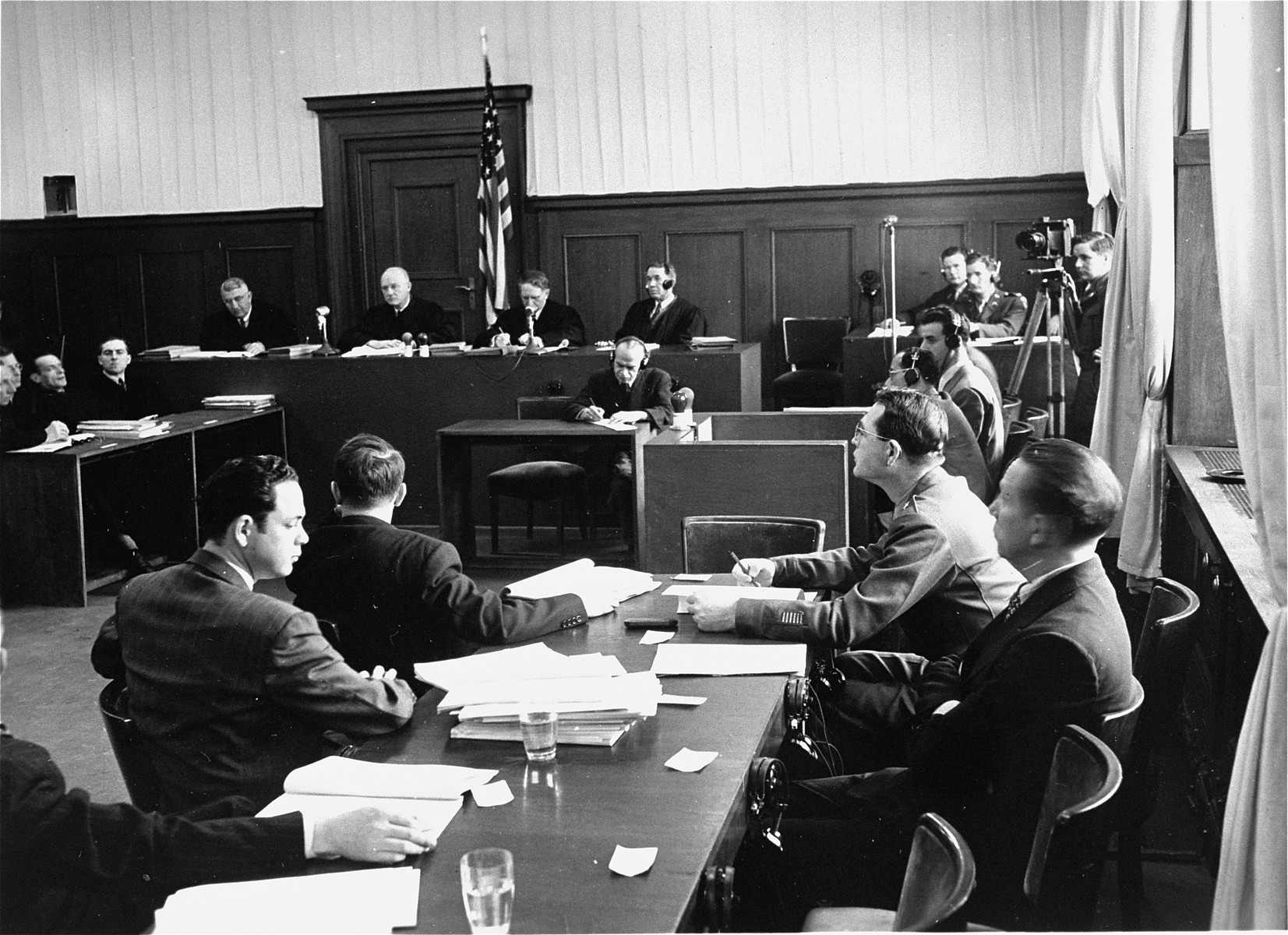 Members of the prosecution team (foreground) during a session of the Milch Trial.  One the left side of table, looking down is Jack Robbins.