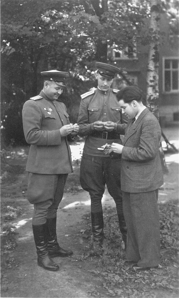 Solly Perel (right) converses with two Soviet officers during his service as a translator for the Red Army.