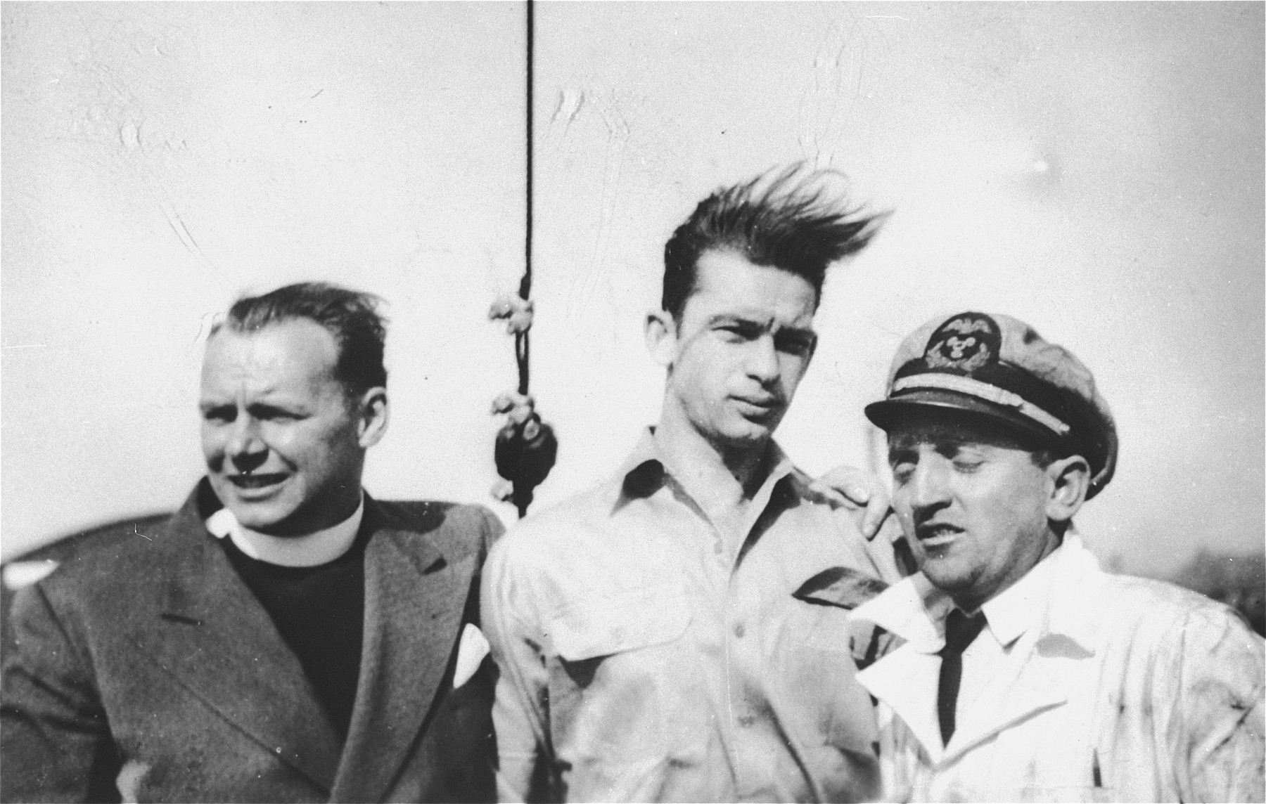 Three crew members pose on the deck of the President Warfield (later the Exodus 1947) before its departure for Europe.    Pictured from left to right are: John Stanley Grauel, Yaakov Oron (Garbash) and Aryeh Kolomeitzev ( later Kole), one of the port engineers who worked on the ship while it was in Baltimore.  He did not sail with the ship.