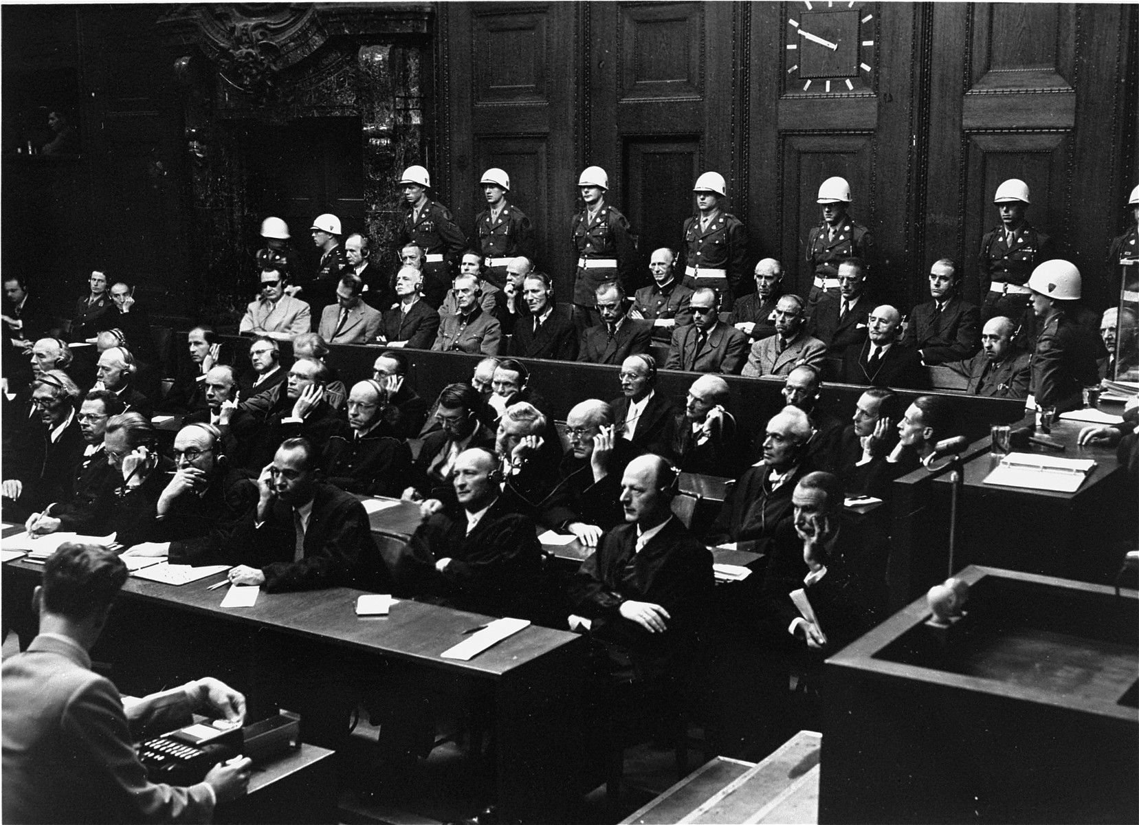 The defendants and their lawyers follow the proceedings at the International Military Tribunal trial of war criminals at Nuremberg.