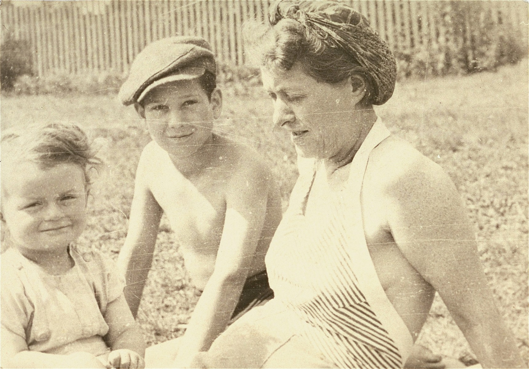 Janek Kon Konorski (center), a Jewish boy in hiding, enjoys a summer holiday with his rescuer, Maria Szelagowska Teski (right) and her daughter, Joanna.  The donor is the son of Maria Teski.