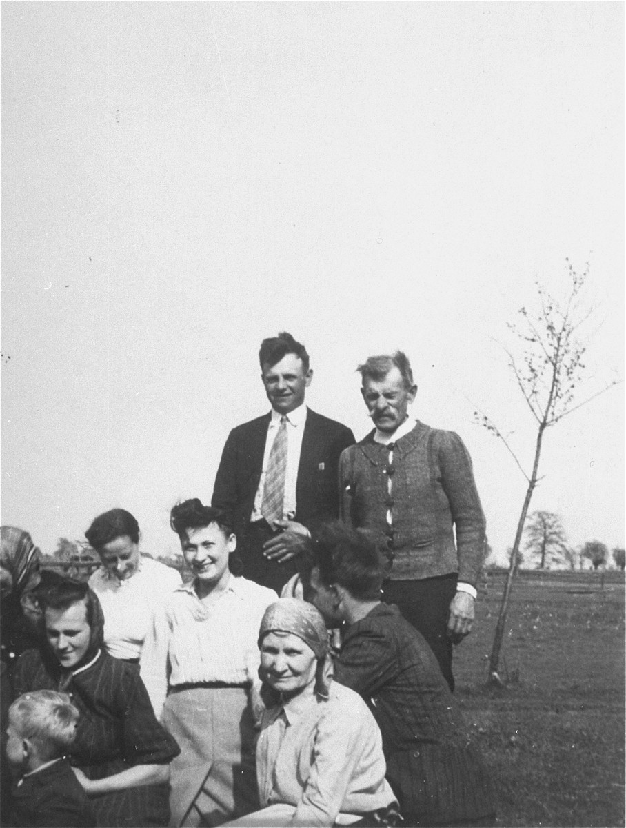 Irka Cymerman (middle), a Polish Jew in hiding, poses with the family she is living with on a farm in Sadolesie (near Malkinia).  The peasant family was not aware that Irka was Jewish.