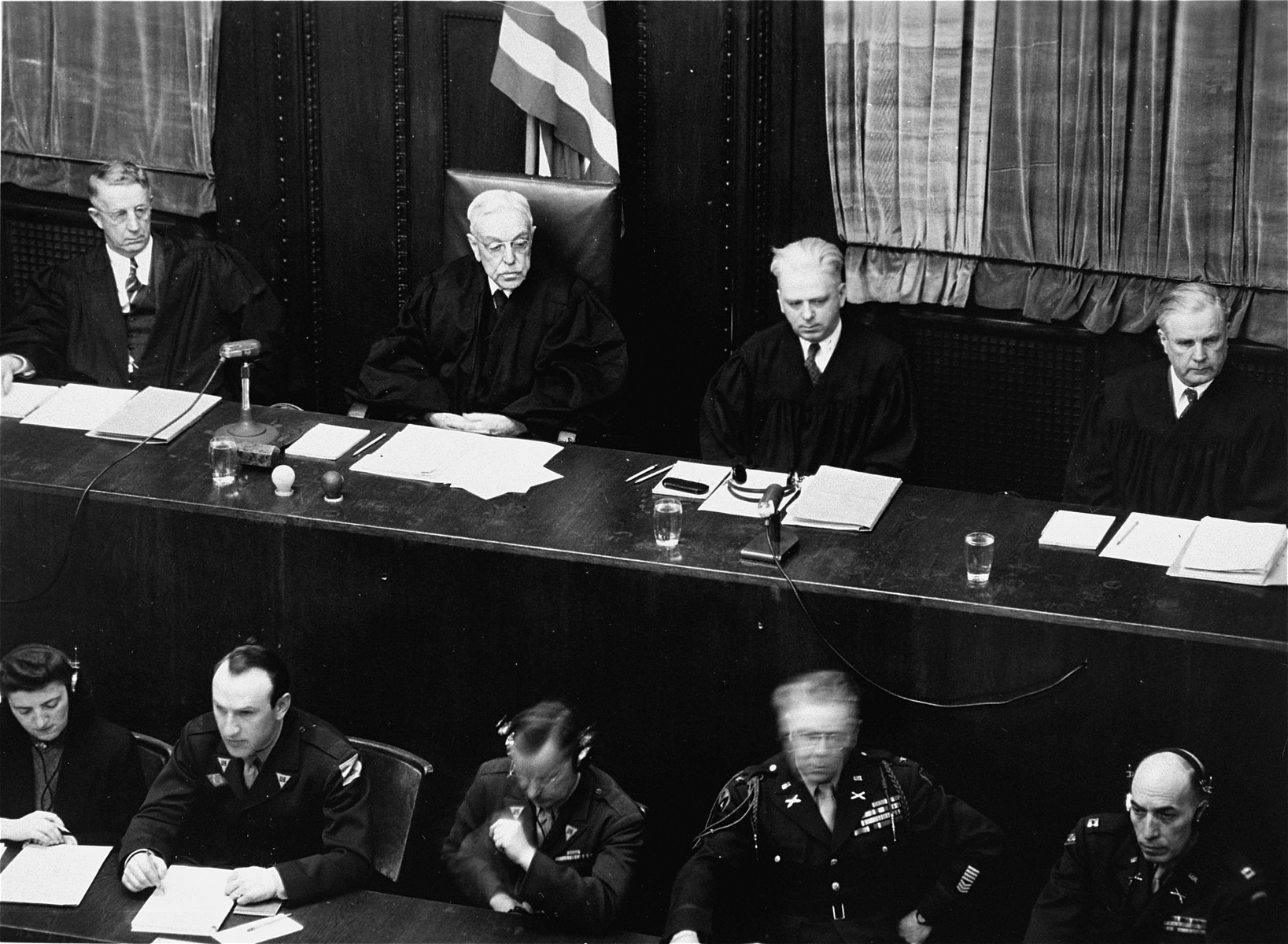 The judges of Military Tribunal IV at the Flick Trial.  From left to right are Frank N. Richman, Charles B. Sears, William C. Christianson, and Richard D. Dixon.