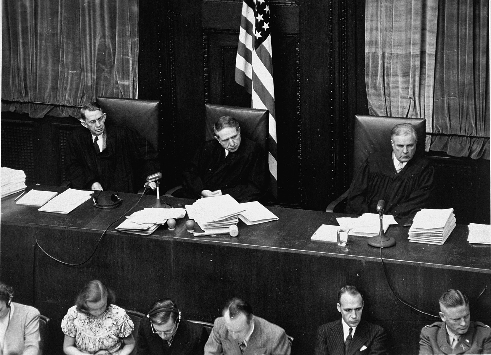The judges of Military Tribunal II-A, listen to the Einsatzgruppen Trial.    From left to right are John J. Speight, Michael A. Musmanno, and Richard D. Dixon.