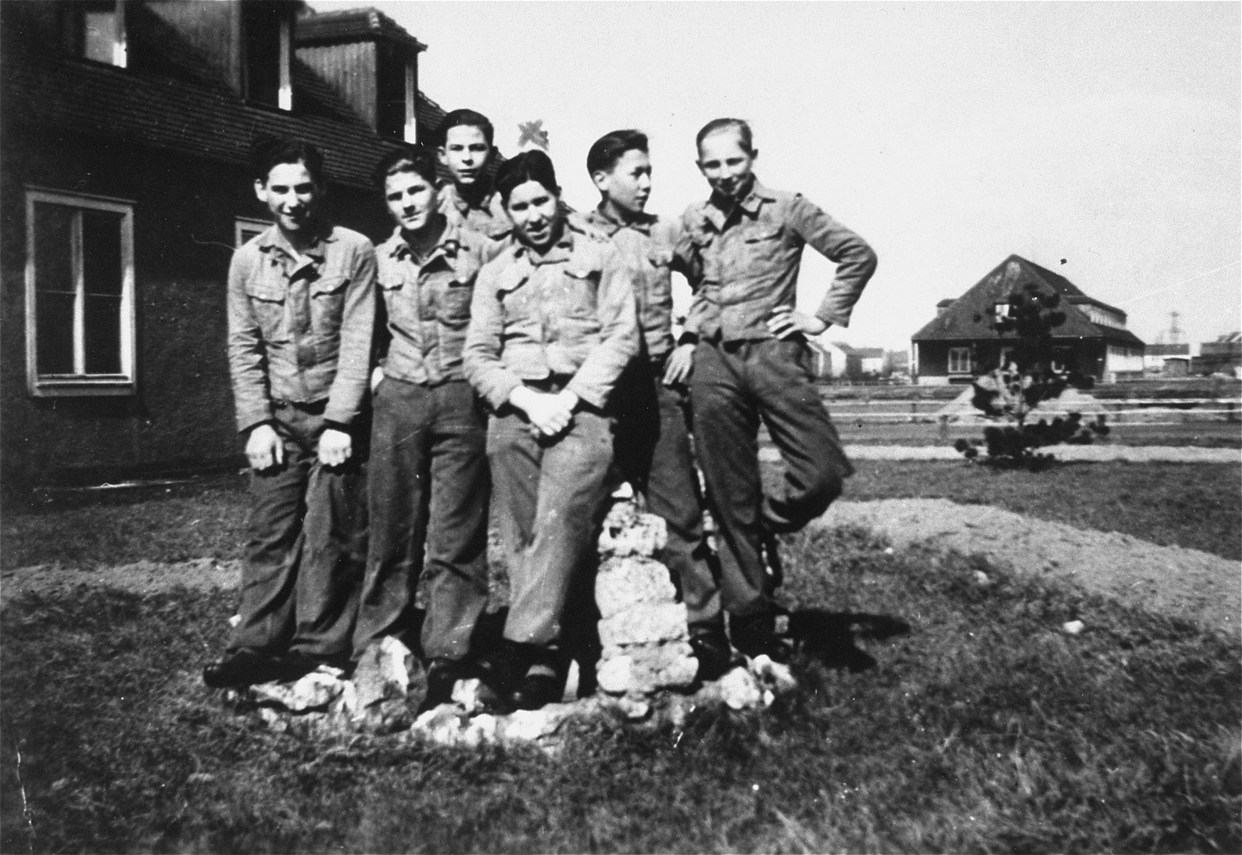 "Group portrait of members of the Hitler Youth in Braunschweig, Germany, including Solly Perel, a Jew living in hiding.  Solly Perel is pictured in the center marked with an ""x""."