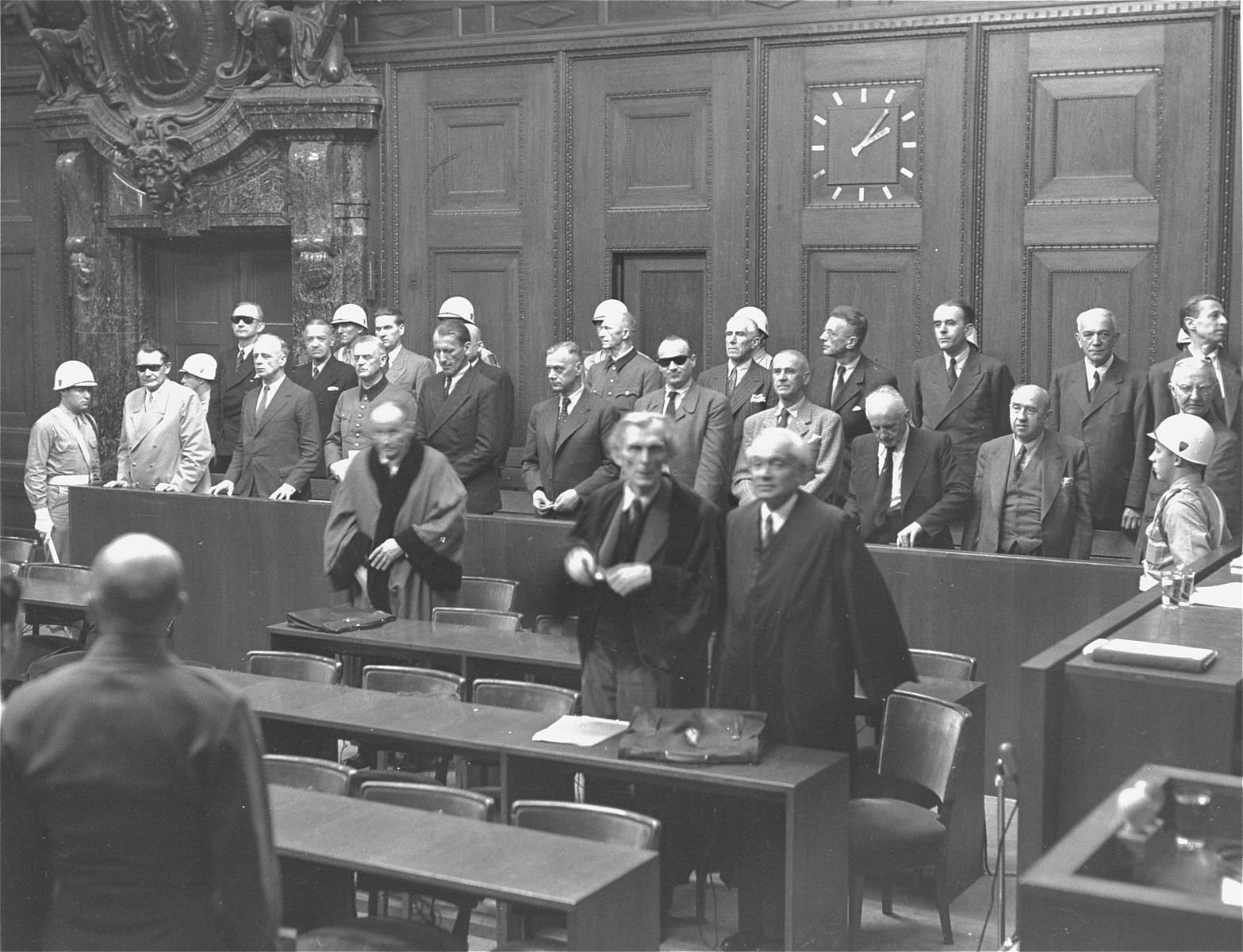 The defendants rise as the judges enter the courtroom at the International Military Tribunal war crimes trial at Nuremberg.