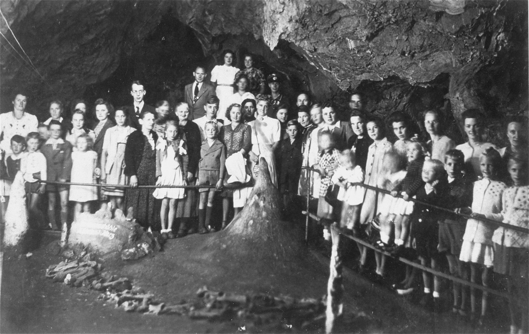 Group portrait of Germans on a field trip to a cavern in the Harz mountains.    Among those pictured is Solly Perel (middle, marked by arrow), a Jew living in hiding as a member of the Hitler Youth.  The field trip was hosted by a German SS officer who worked at the Hitler Youth school in Braunschweig.
