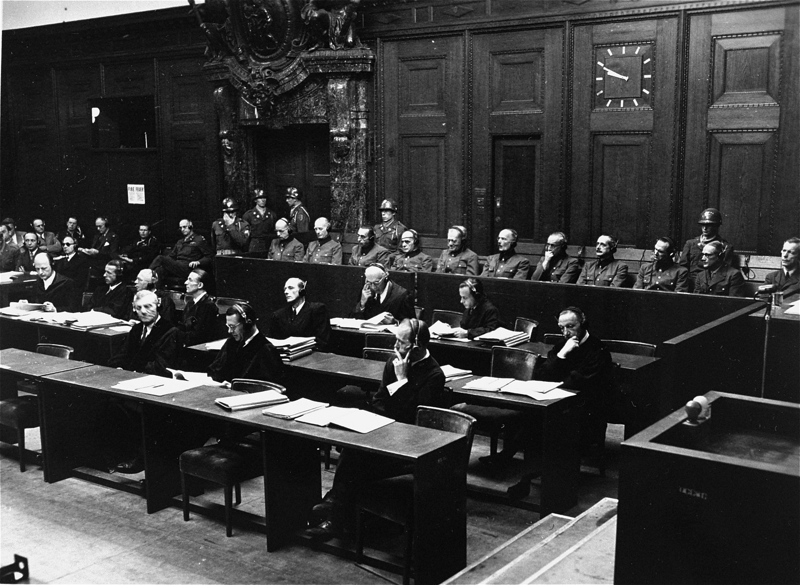 The defendants in the dock and their lawyers follow the proceedings of the Hostage Case.