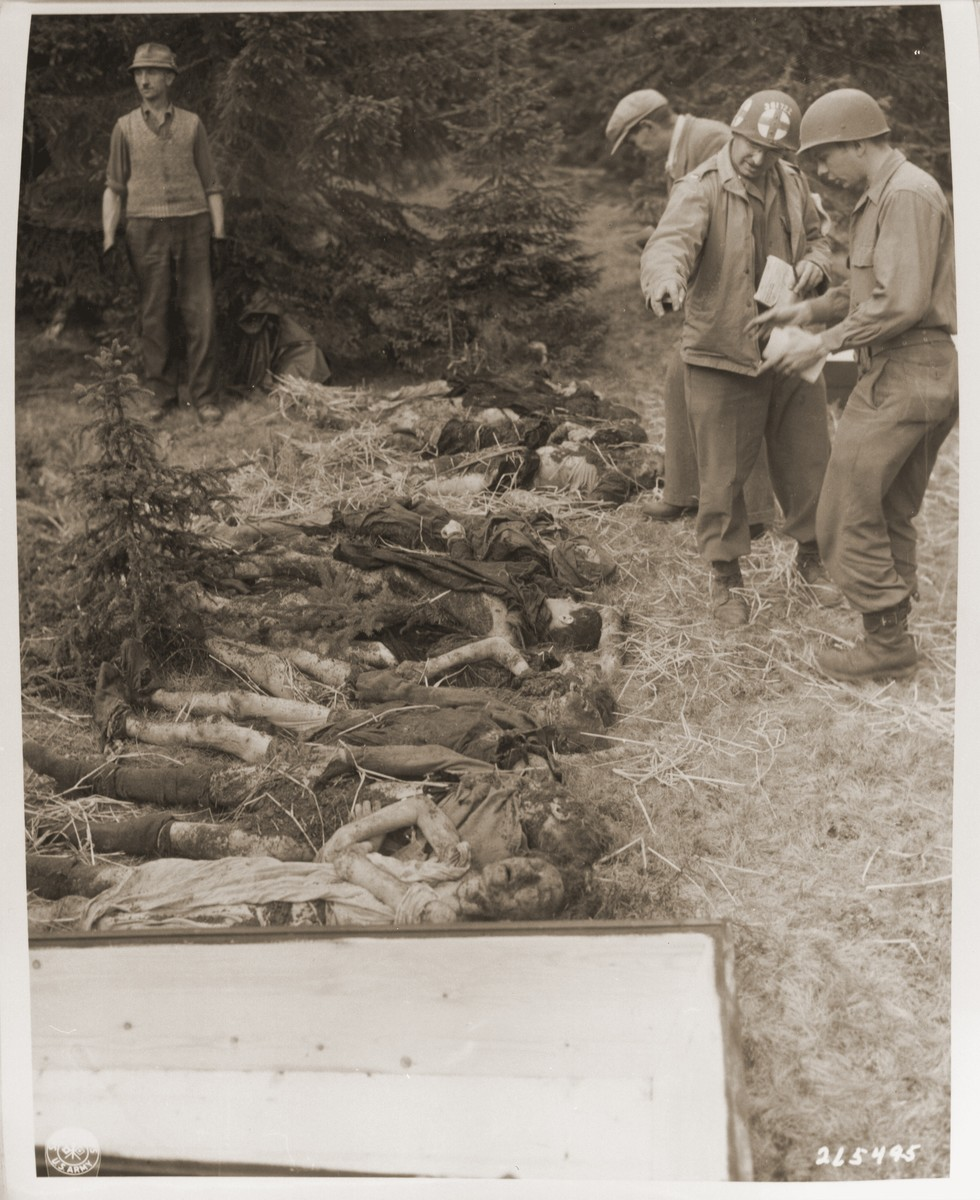 U.S. Army medical personnel identify the bodies of Jewish women exhumed from a mass grave near Volary.  The victims died at the end of a death march from Helmbrechts, a sub-camp of Flossenbuerg.
