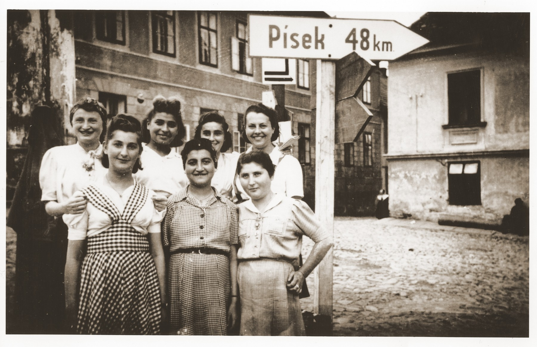 Seven of the approximately 150 survivors of a 500 km. death march that ended in Volary.  These Jewish survivors are recuperating in Prachatice, near Volary.   Pictured from left to right in the front row are: Hela Malinowicz (Malnowicer Bleeman) (from Dabrowa); Rachela Raabe; and Regina Szapelska (from Sosnowiec).   In the back row, left to right are: Hela Dancygier; Lilka Silbiger (from Oswiecim); Fela Lewy; and Fela Zyngler (from Lodz).