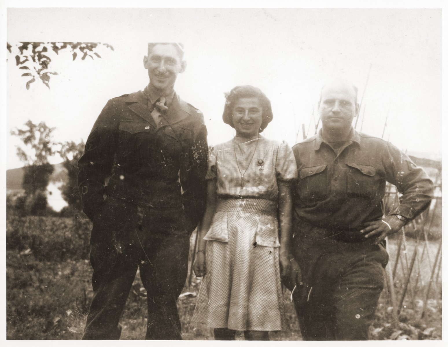 Two Jewish American soldiers from the 3rd U.S. Army pose with Halina Goldberg from Czestochowa.    Halina was one of approximately 150 Jewish women sent on a 500 km. death march that ended in Volary. The survivors recouperated in Prachatice, near Volary.