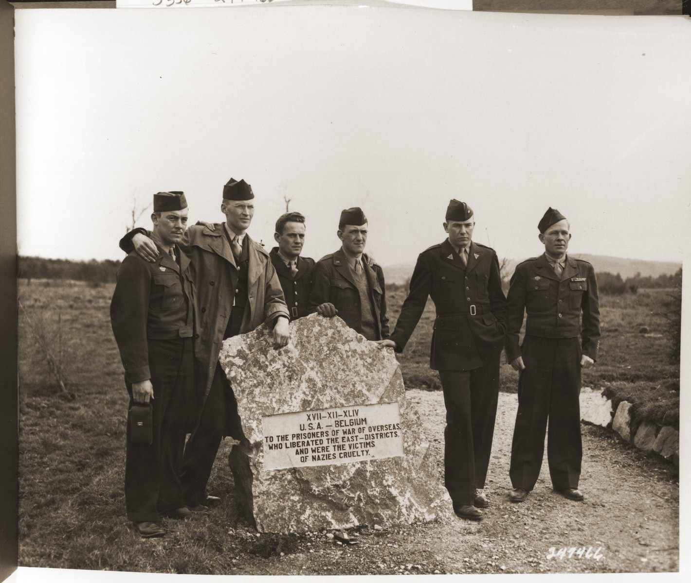 Six survivors of the Malmedy atrocity return to the field where SS troops of the First SS Panzer Division shot and killed 86 unarmed American soldiers on December 17, 1944.    These six survivors were flown to the site to testify.  The six survivors are Samuel Dobyns, Sandusky, Ohio; Kenneth F. Ahrens, Erie, Pa.; Omar D. Ford, Leeton, Mo.; Kenneth E. Kingston, Allentown, Pa.; Carl R. Daub, Colebrook, Pa.; and Virgil P. Larry, Lexington, Kentucky.